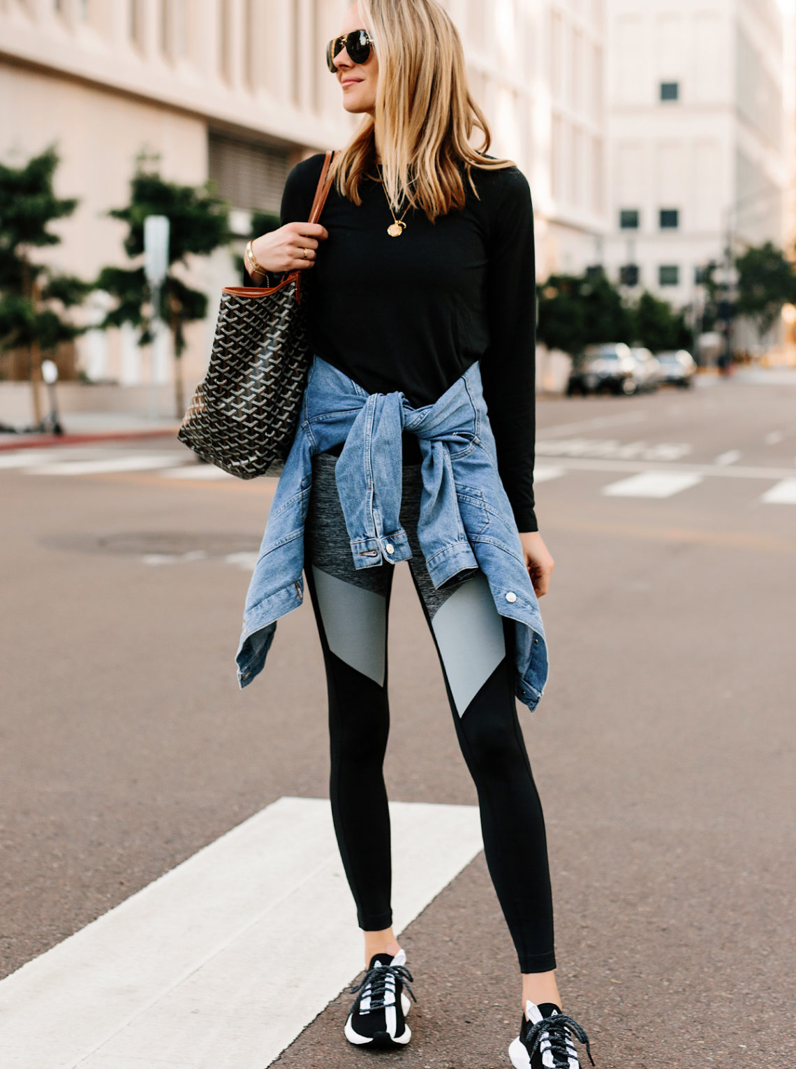 Blonde Woman Wearing Black Long Sleeve Top Denim Jacket Reebok Colorblock Leggings Reebok Sole Fury Black Sneakers Goyard Tote Fashion Jackson San Diego Fashion Blogger Athleisure Outfit