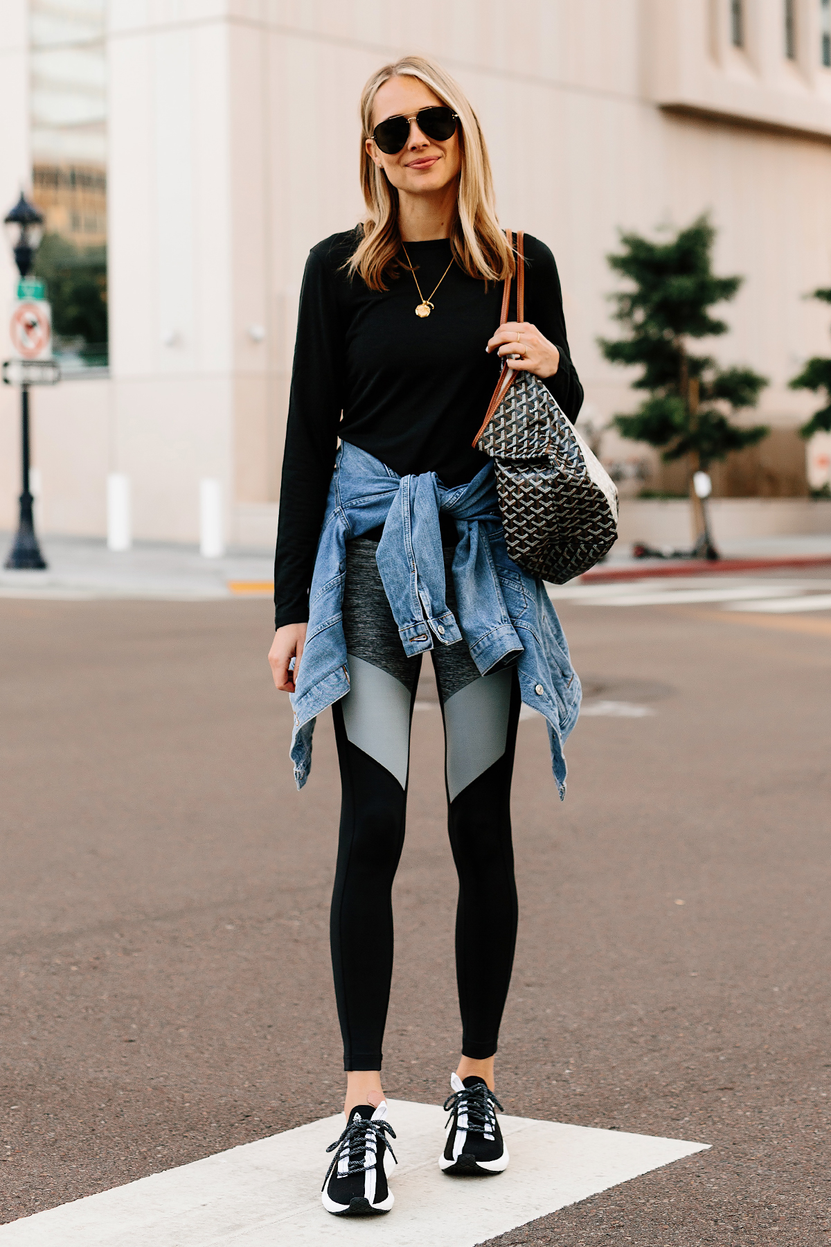Blonde Woman Wearing Black Long Sleeve Top Denim Jacket Reebok Colorblock Leggings Reebok Sole Fury Black Sneakers Goyard Tote Fashion Jackson San Diego Fashion Blogger Street Style Athleisure Outfit