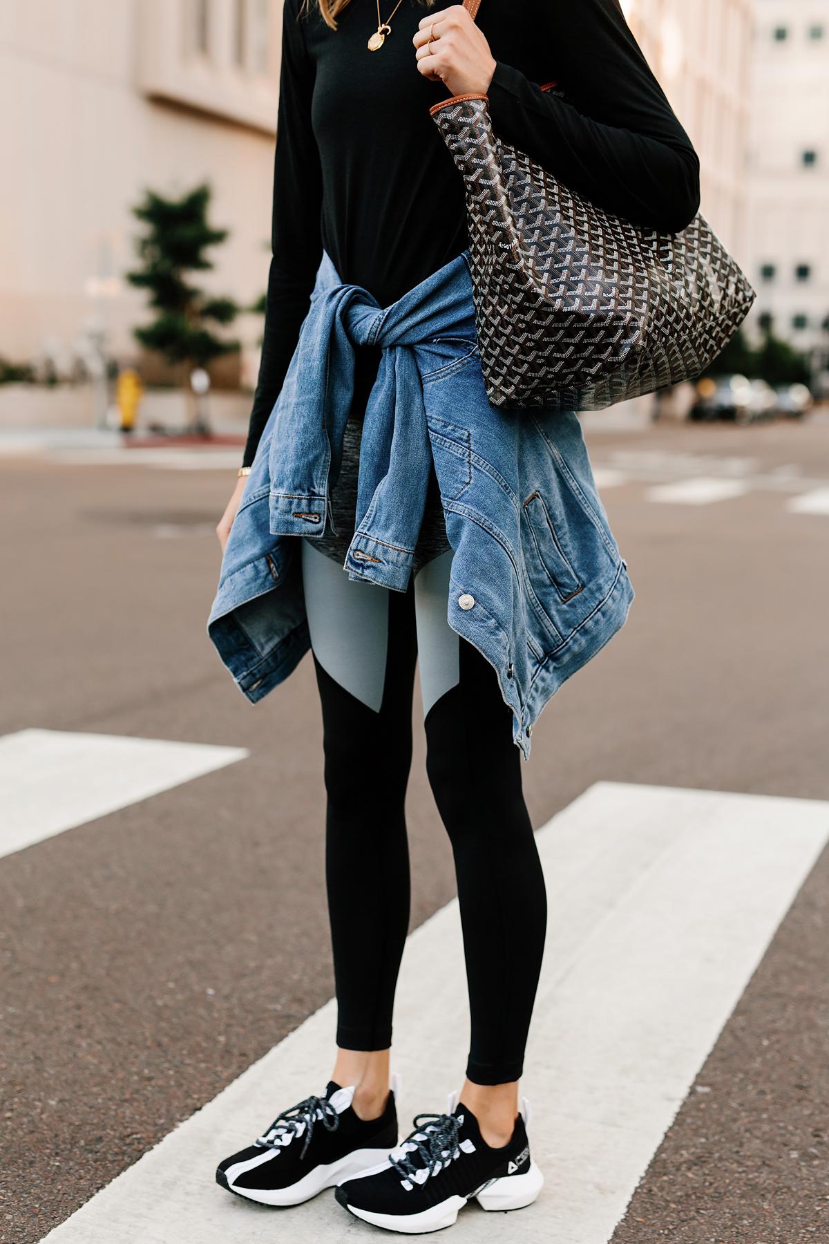 Woman Wearing Black Long Sleeve Top Denim Jacket Reebok Colorblock Leggings Reebok Sole Fury Black Sneakers Goyard Tote Fashion Jackson San Diego Fashion Blogger Athleisure Outfit