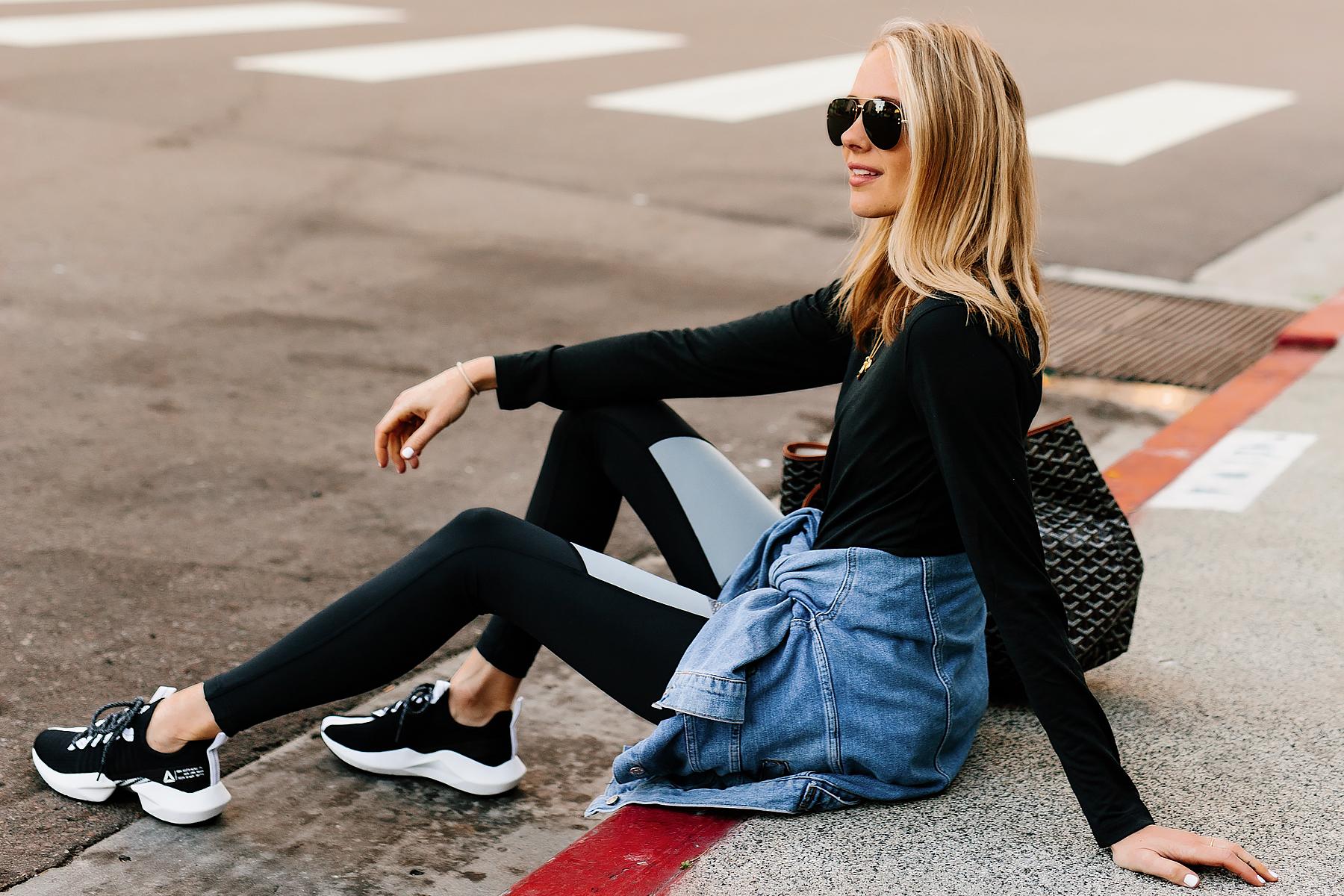 Blonde Woman Wearing Black Long Sleeve Top Denim Jacket Reebok Colorblock Leggings Reebok Sole Fury Black Sneakers Fashion Jackson San Diego Fashion Blogger Athleisure Outfit