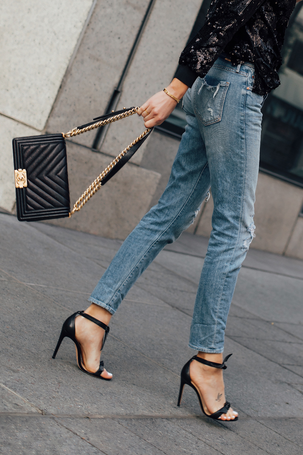 Woman Wearing Black Sequin Top Mother Denim Ripped Jeans Chanel Black Boy Bag Black Heeled Sandals Fashion Jackson San Diego Fashion Blogger Street Style NYE Outift