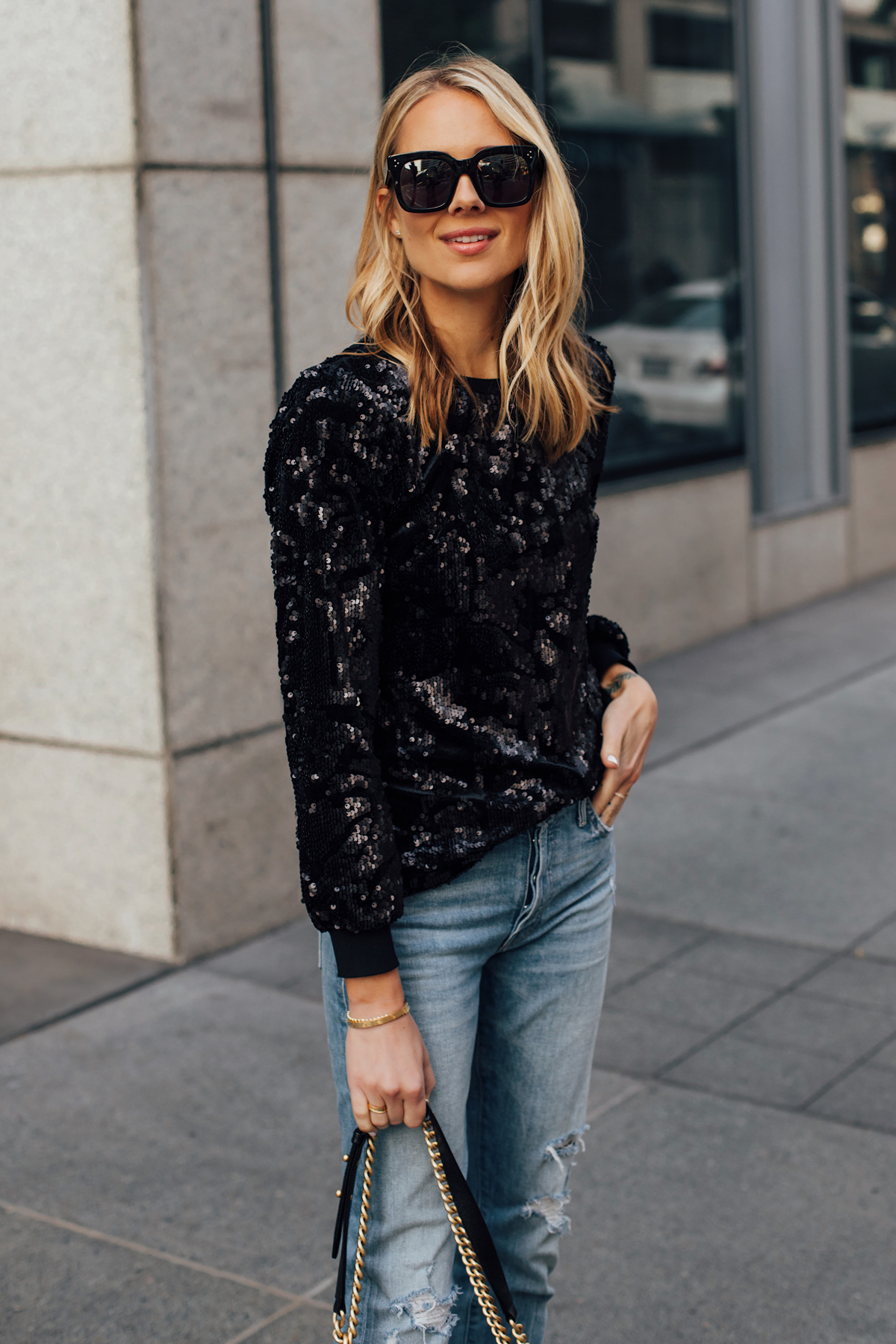 Blonde Woman Wearing Black Sequin Top Ripped Skinny Jeans Black Celine Tilda Sunglasses Fashion Jackson San Diego Fashion Blogger Street Style NYE Outfit