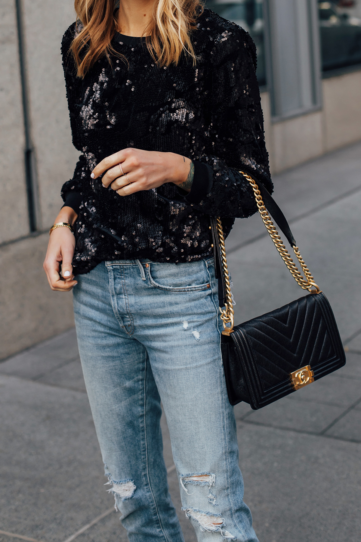 Blonde Woman Wearing Black Sequin Top Ripped Skinny Jeans Chanel Black Boy Bag Fashion Jackson San Diego Fashion Blogger Street Style NYE Outfit