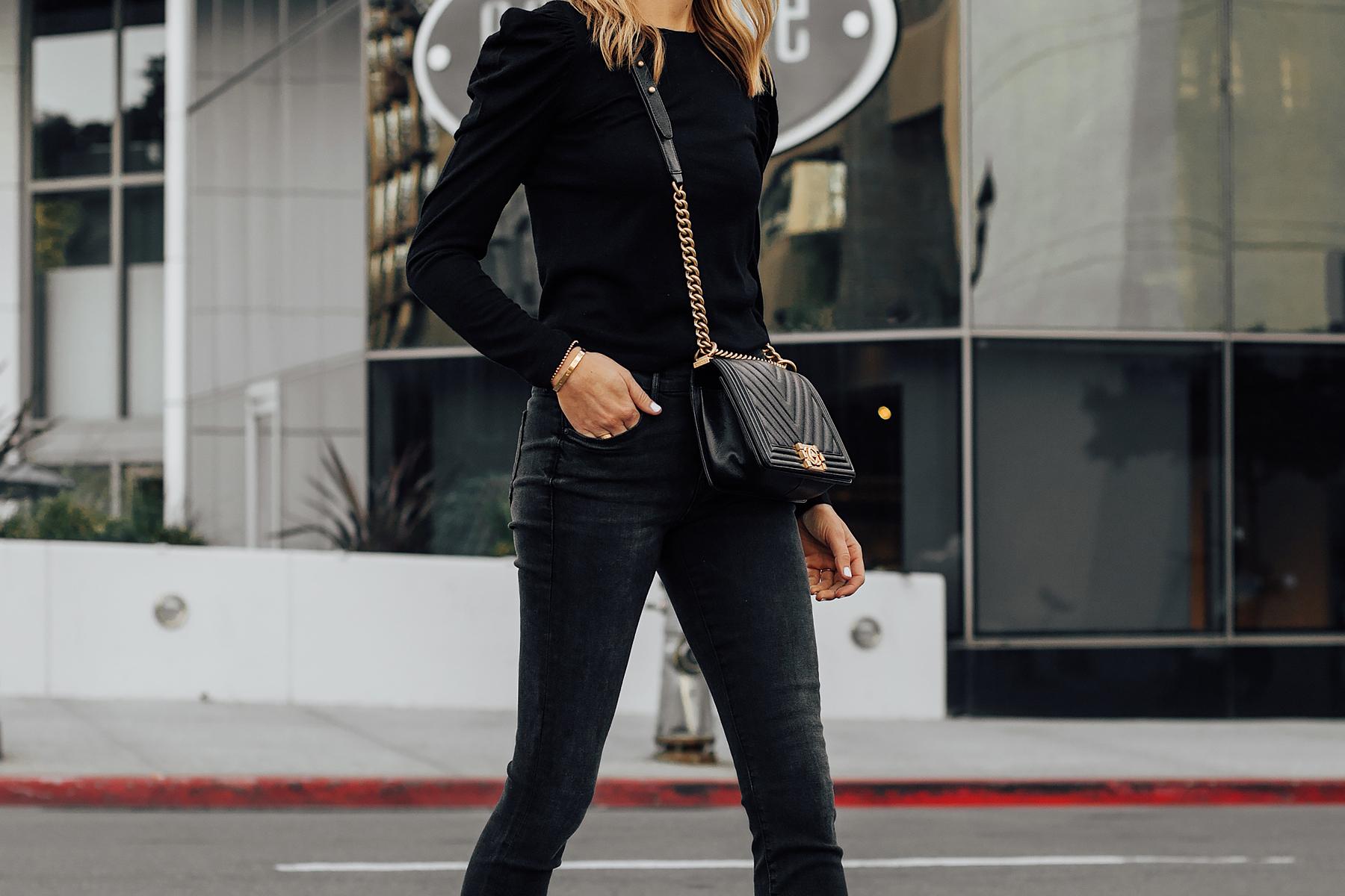 Blonde Woman Wearing Black Sweater Black Skinny Jeans Chanel Black Boy Bag Fashion Jackson San Diego Fashion Blogger Street Style