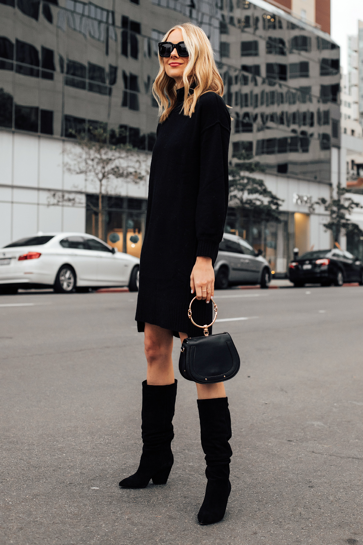 Blonde Woman Wearing Black Sweater Dress Black Slouchy Boots Fashion Jackson San Diego Fashion Blogger Street Style