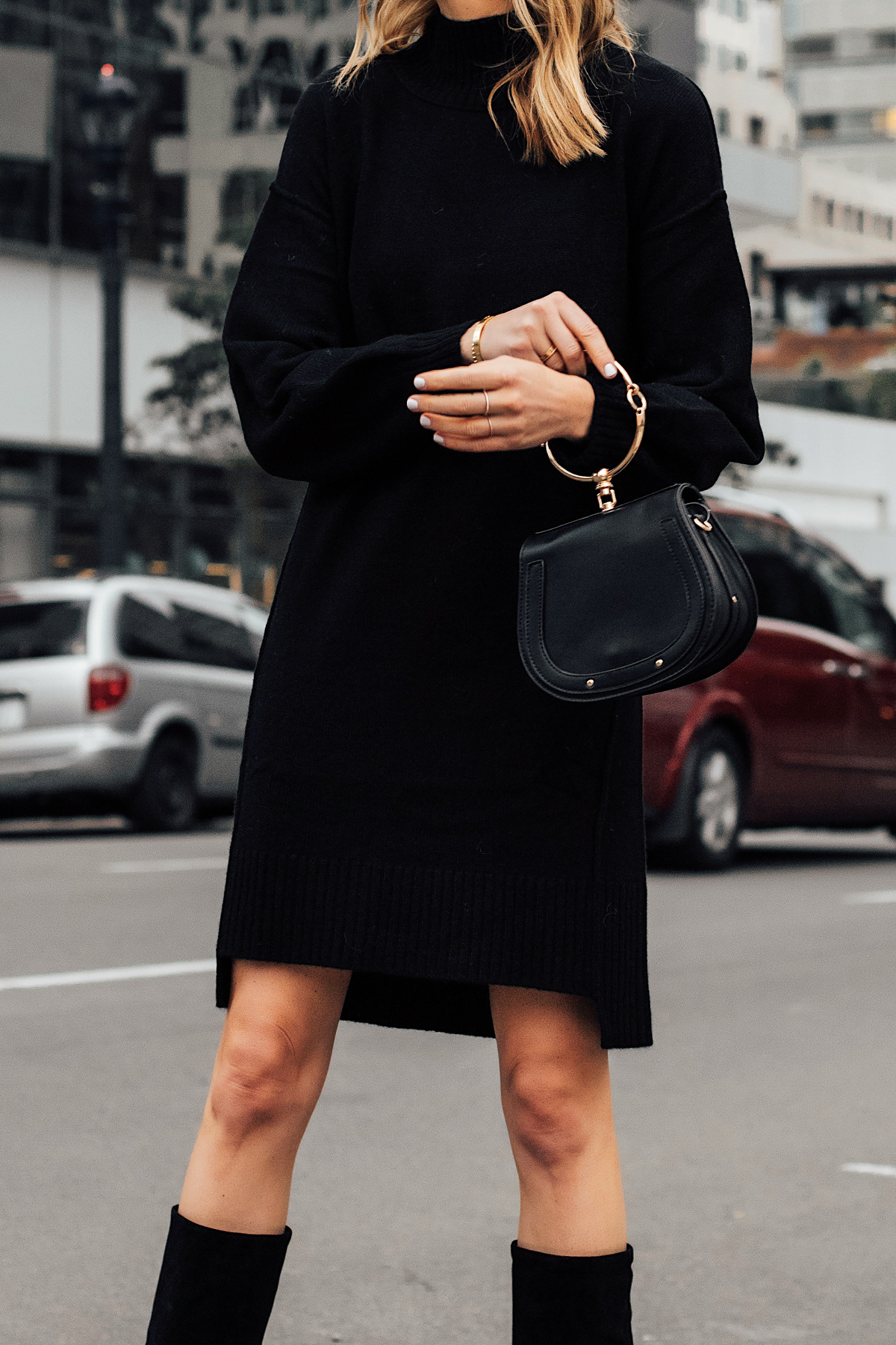 Woman Wearing Black Sweater Dress Black Tall Boots Black Clutch Handbag Fashion Jackson San Diego Fashion Blogger Street Style