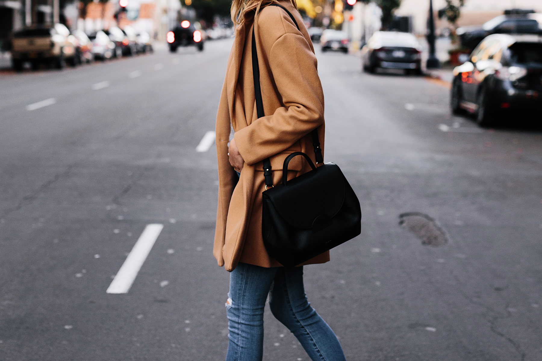Blonde Woman Wearing Camel Coat Black Satchel Handbag Denim Skinny Jeans Fashion Jackson San Diego Fashion Blogger Street Styke