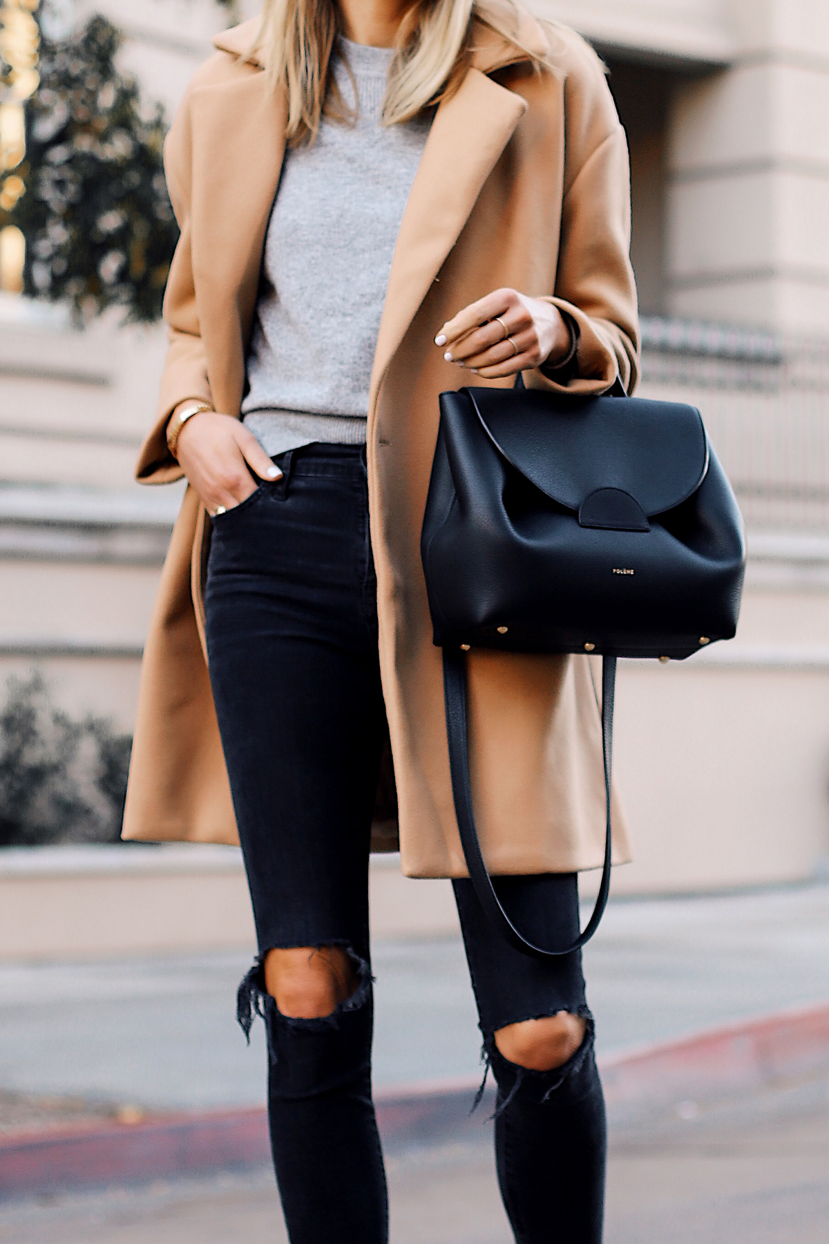 Blonde Woman Wearing Camel Coat Grey Sweater Black Ripped Skinny Jeans Polene Black Satchel Handbag Fashion Jackson San Diego Fashion Blogger Street Style