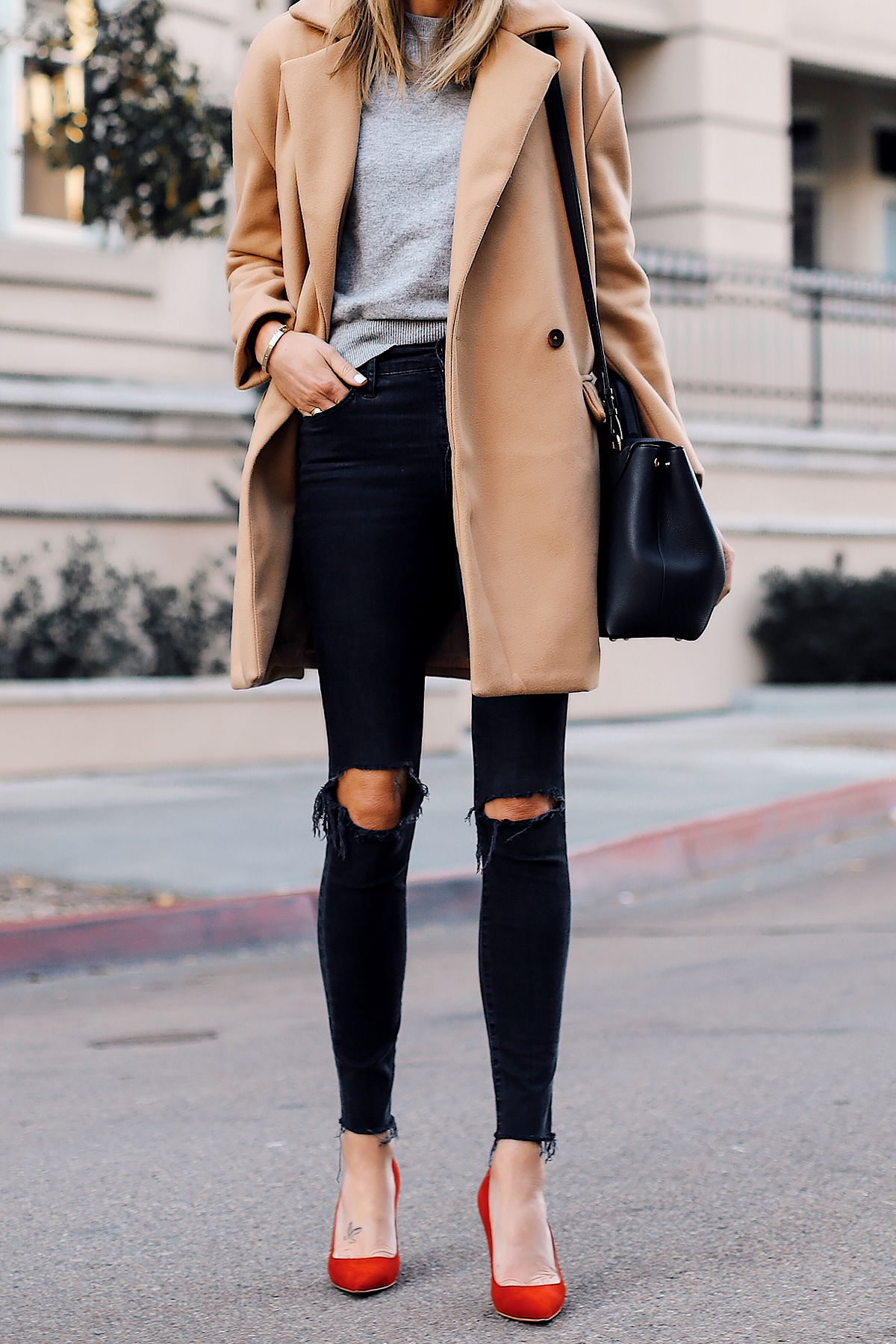 Blonde Woman Wearing Camel Coat Grey Sweater Black Ripped Skinny Jeans Red Pumps Outfit Fashion Jackson San Diego Fashion Blogger Street Style