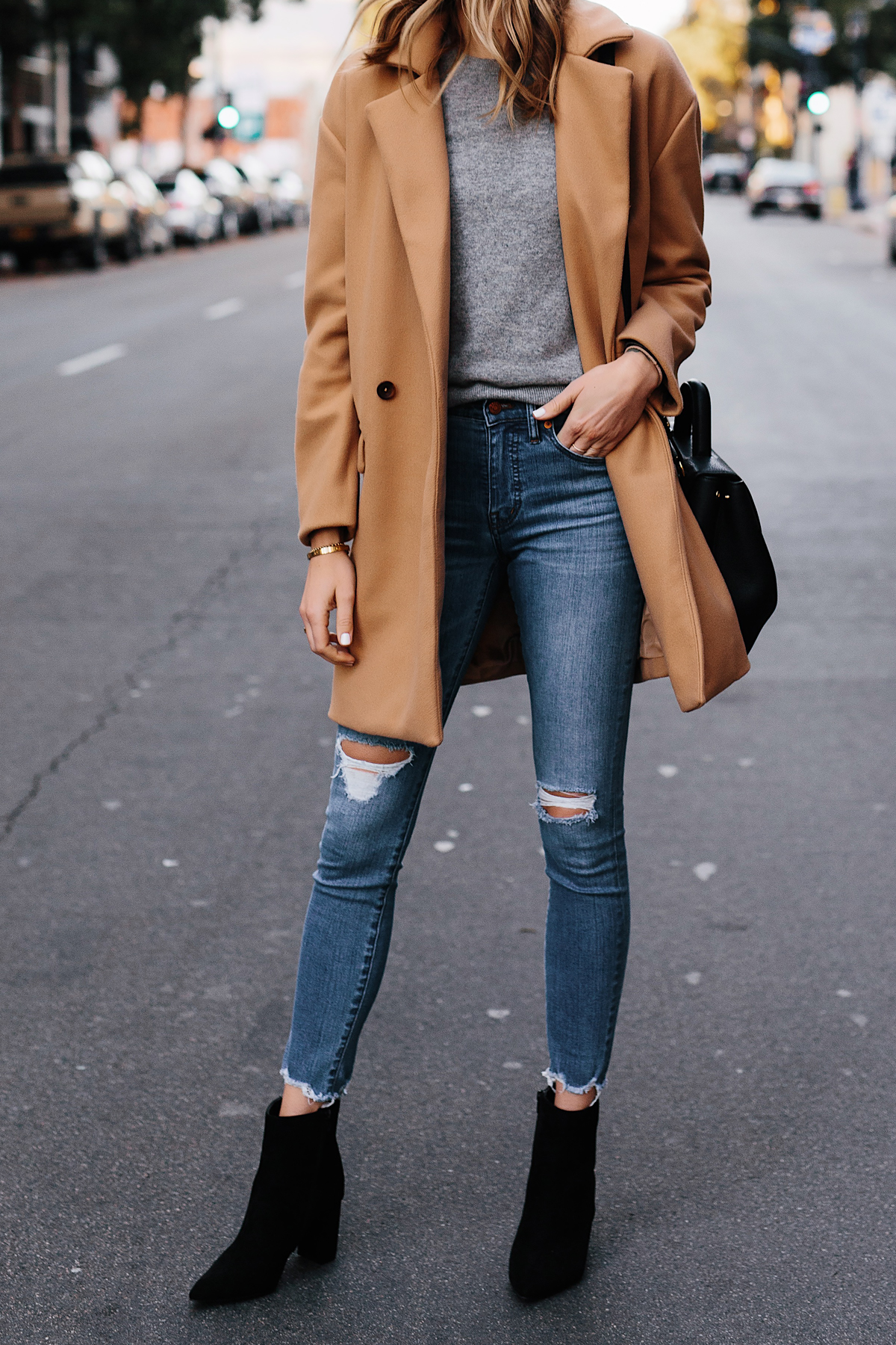 Woman Wearing Camel Coat Grey Sweater Denim Ripped Skinny Jeans Black Booties Outfit Fashion Jackson San Diego Fashion Blogger Street Style
