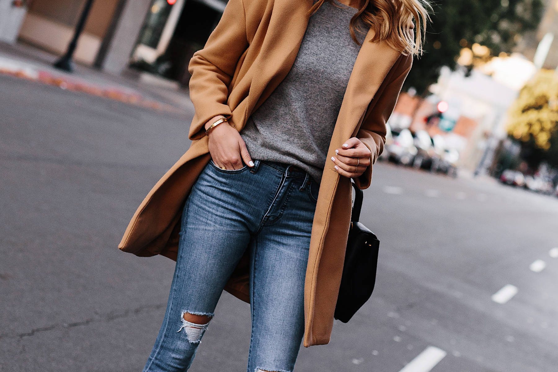 Woman Wearing Camel Coat Grey Sweater Denim Ripped Skinny Jeans Outfit Fashion Jackson San Diego Fashion Blogger Street Style