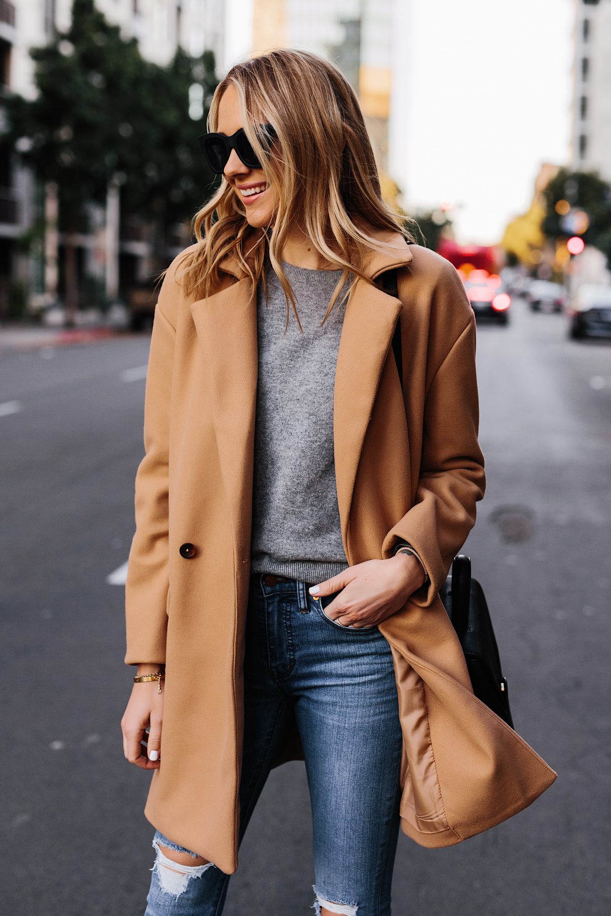 Blonde Woman Wearing Camel Coat Grey Sweater Denim Ripped Skinny Jeans Outfit Fashion Jackson San Diego Fashion Blogger Street Style