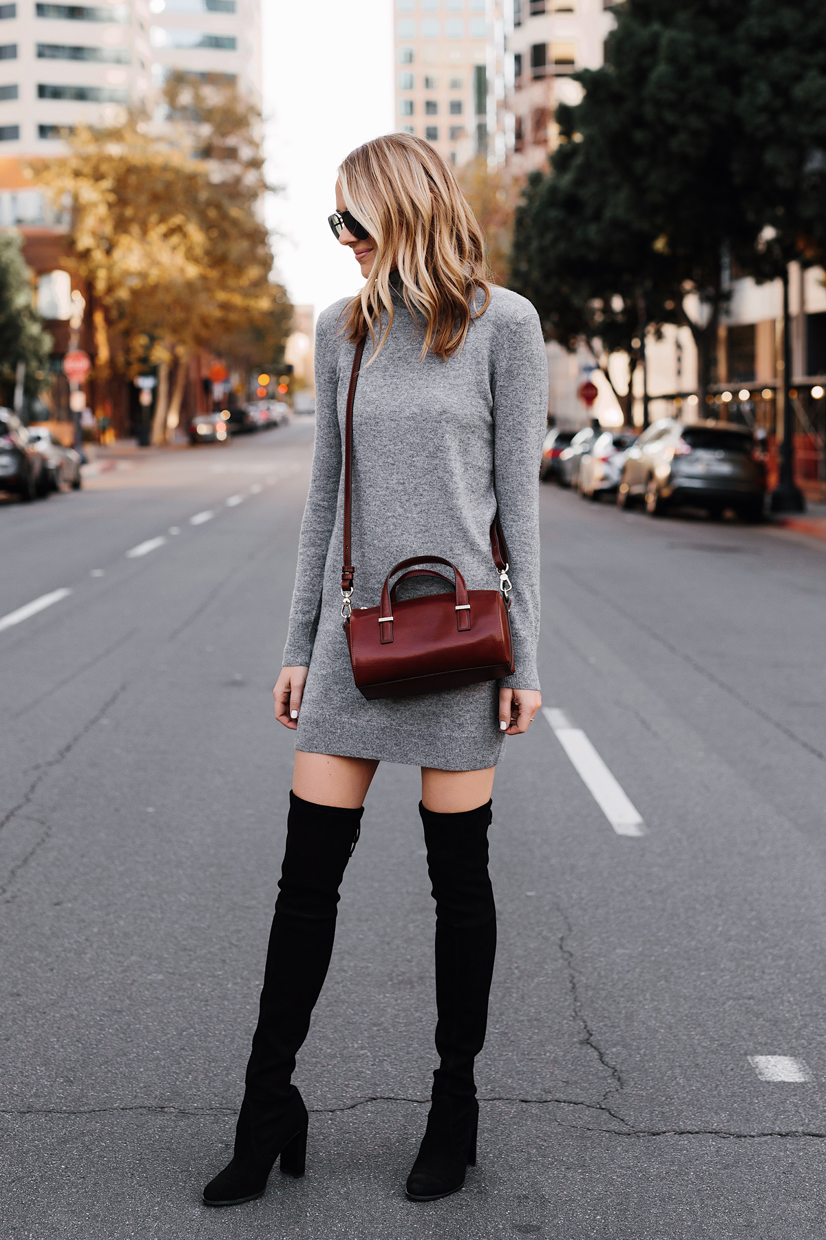 Blonde Woman Wearing Grey Sweater Dress Stuart Weitzman Black Over the Knee Boots Brahmin Brown Crossbody Fashion Jackson San Diego Fashion Blogger Street Style