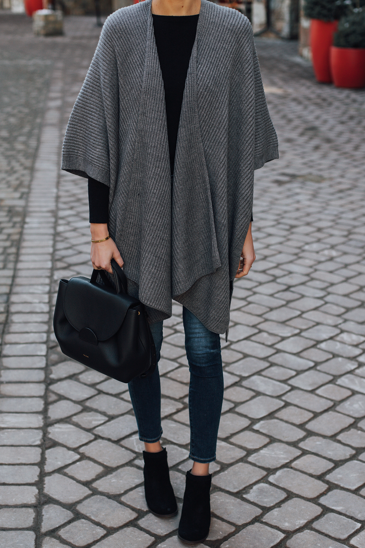Woman Wearing Grey Sweater Poncho Black Top Denim Skinny Jeans Polene Black Handbag Black Booties Fashion Jackson San Diego Fashion Blogger Street Style