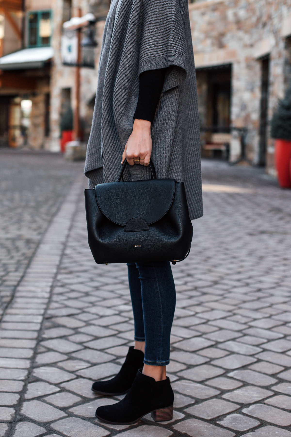 Woman Wearing Grey Sweater Poncho Denim Skinny Jeans Koolaburra Black Booties Polene Black Handbag Fashion Jackson San Diego Fashion Blogger Street Style