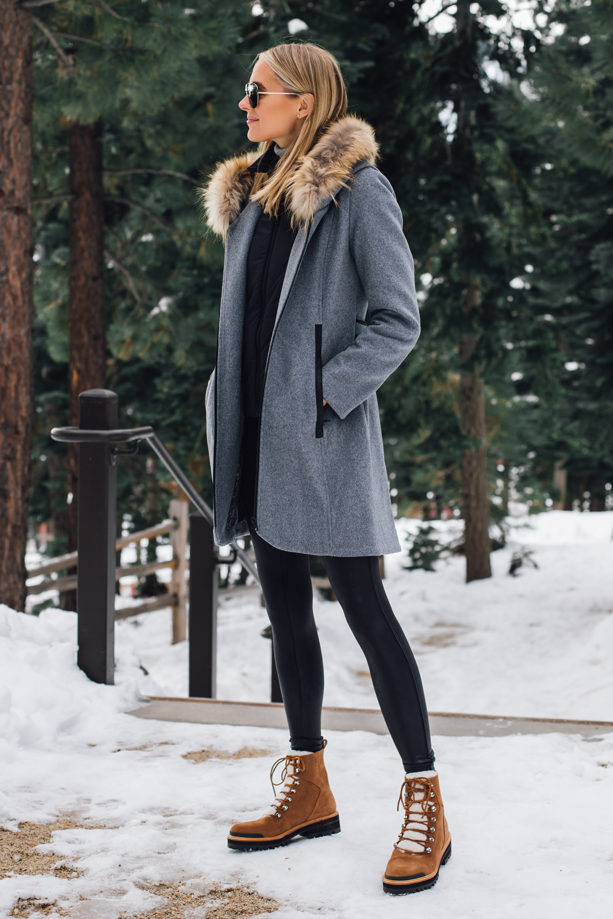 Blonde Woman Wearing Grey Wool Coat with Faux Fur Hood Spanx Black Faux Leather Leggings Brown Shearling Booties Outfit Fashion Jackson San Diego Fashion Blogger Lake Tahoe Winter Outfit