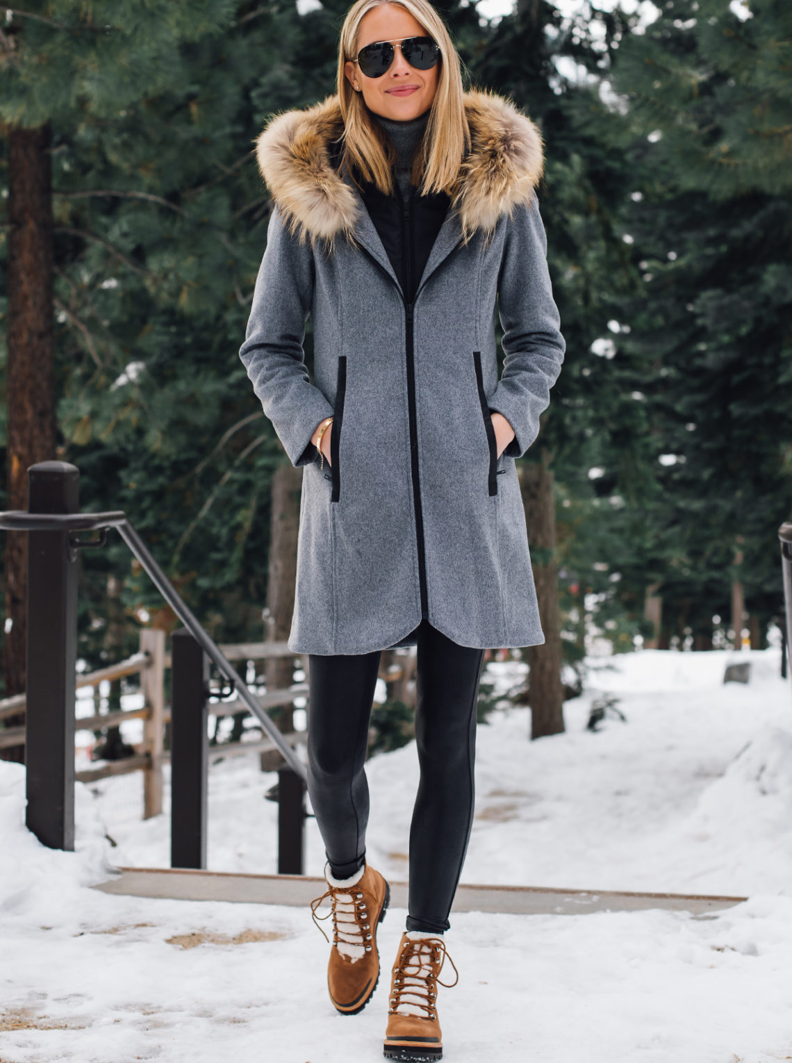 Blonde Woman Wearing Grey Wool Coat with Faux Fur Hood Spanx Black Faux Leather Leggings Marc Fisher Brown Suede Shearling Booties Outfit Fashion Jackson San Diego Fashion Blogger Lake Tahoe Winter Outfit