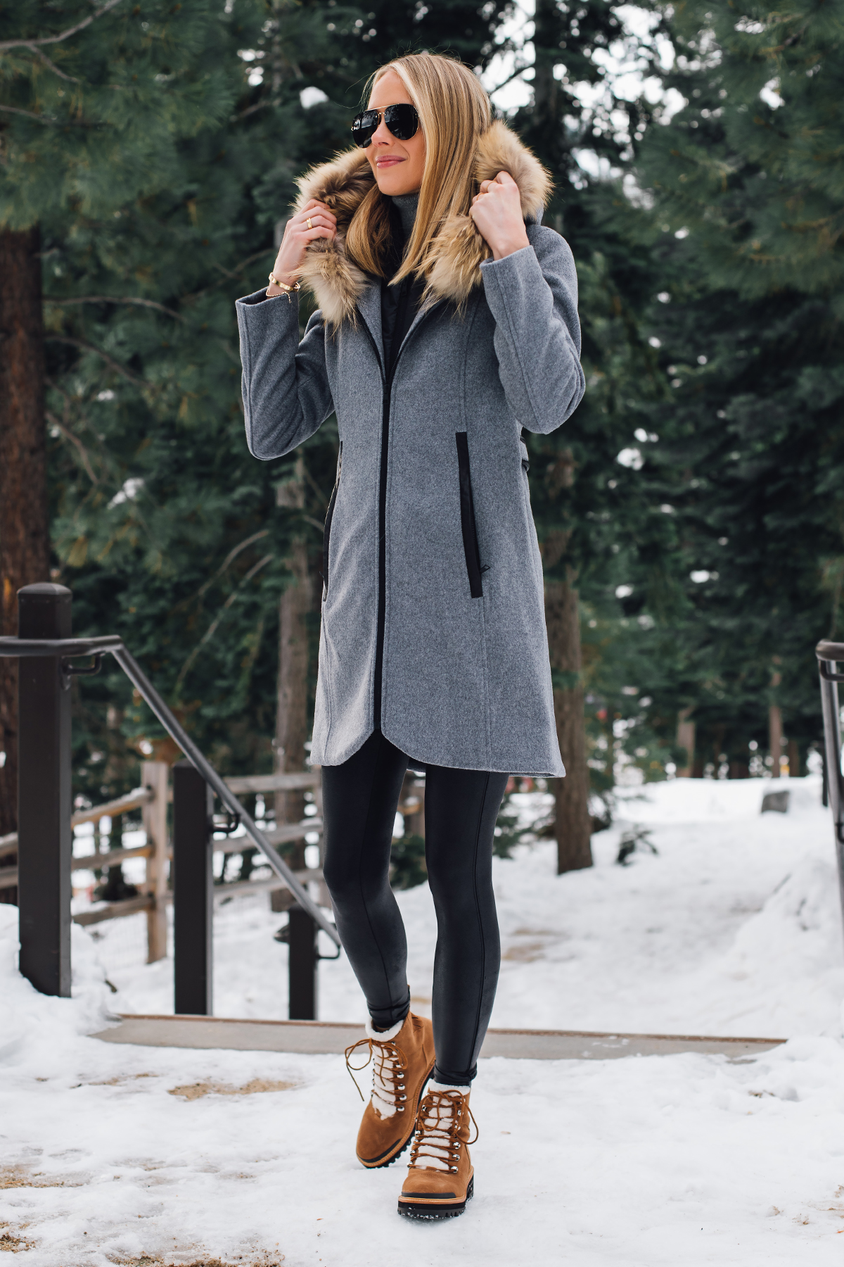 Blonde Woman Wearing Grey Wool Coat with Faux Fur Hood Spanx Black Faux Leather Leggings Marc Fisher Shearling Brown Booties Outfit Fashion Jackson San Diego Fashion Blogger Lake Tahoe Winter Outfit
