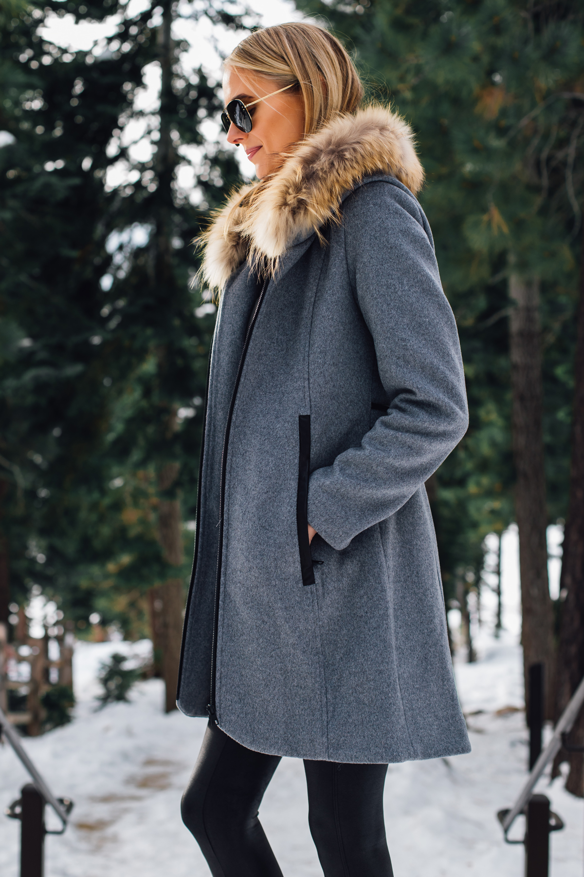Blonde Woman Wearing Grey Wool Coat with Faux Fur Hood Fashion Jackson San Diego Fashion Blogger Lake Tahoe Winter Outfit
