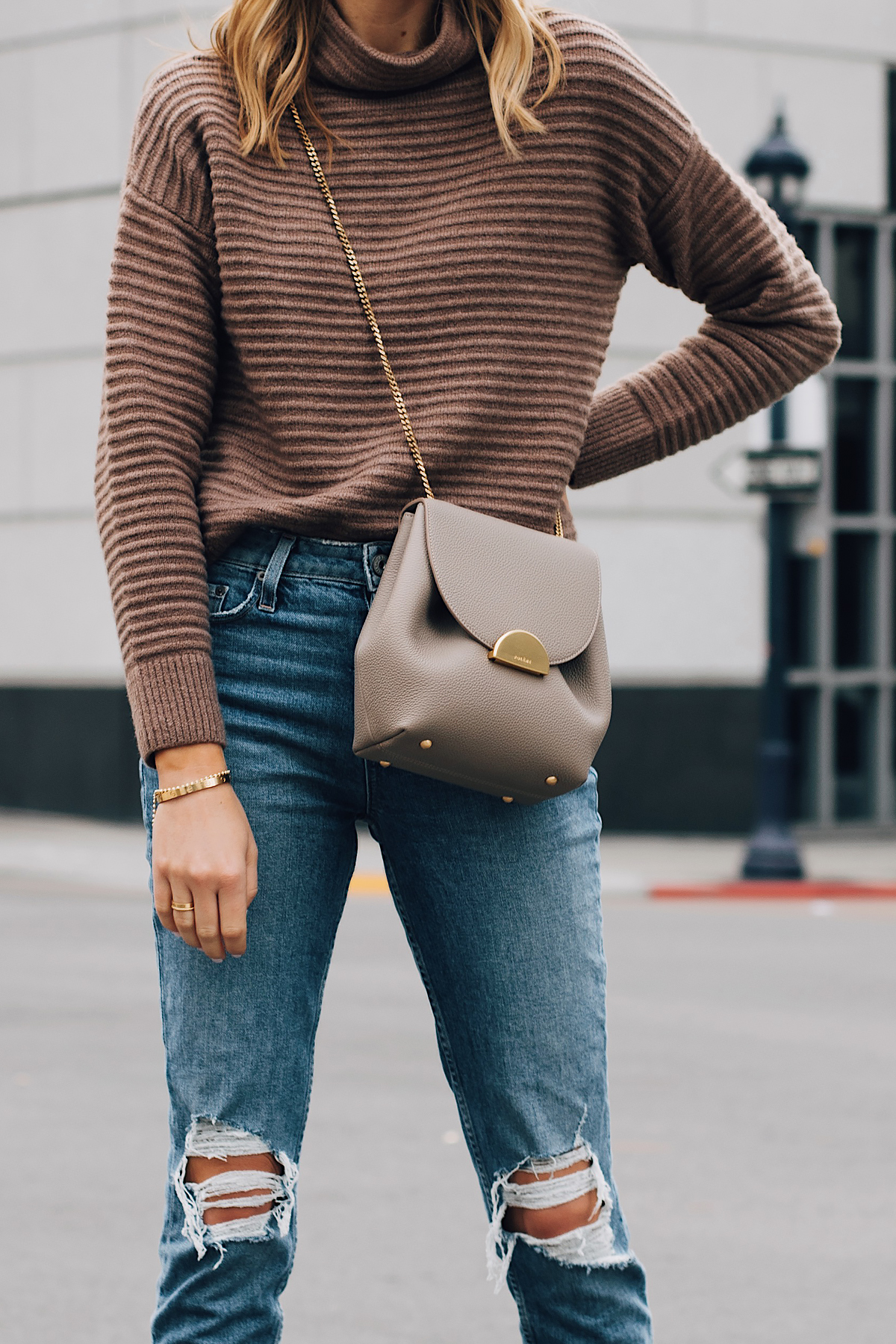 Blonde Woman Wearing Madewell Brown Mock Neck Sweater Paige Ripped Jeans Polene Grey Handbag Fashion Jackson San Diego Fashion Blogger Street Style