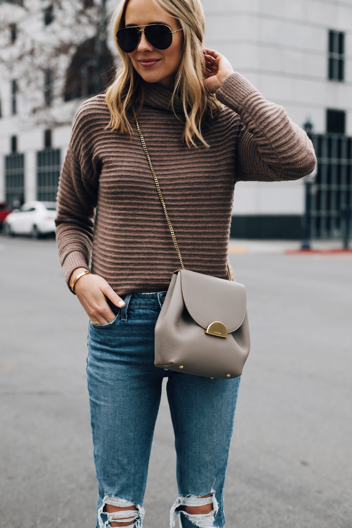 Blonde Woman Wearing Madewell Brown Mock Neck Sweater Paige Ripped Jeans Polene Grey Handbag Aviator Sunglasses Fashion Jackson San Diego Fashion Blogger Street Style