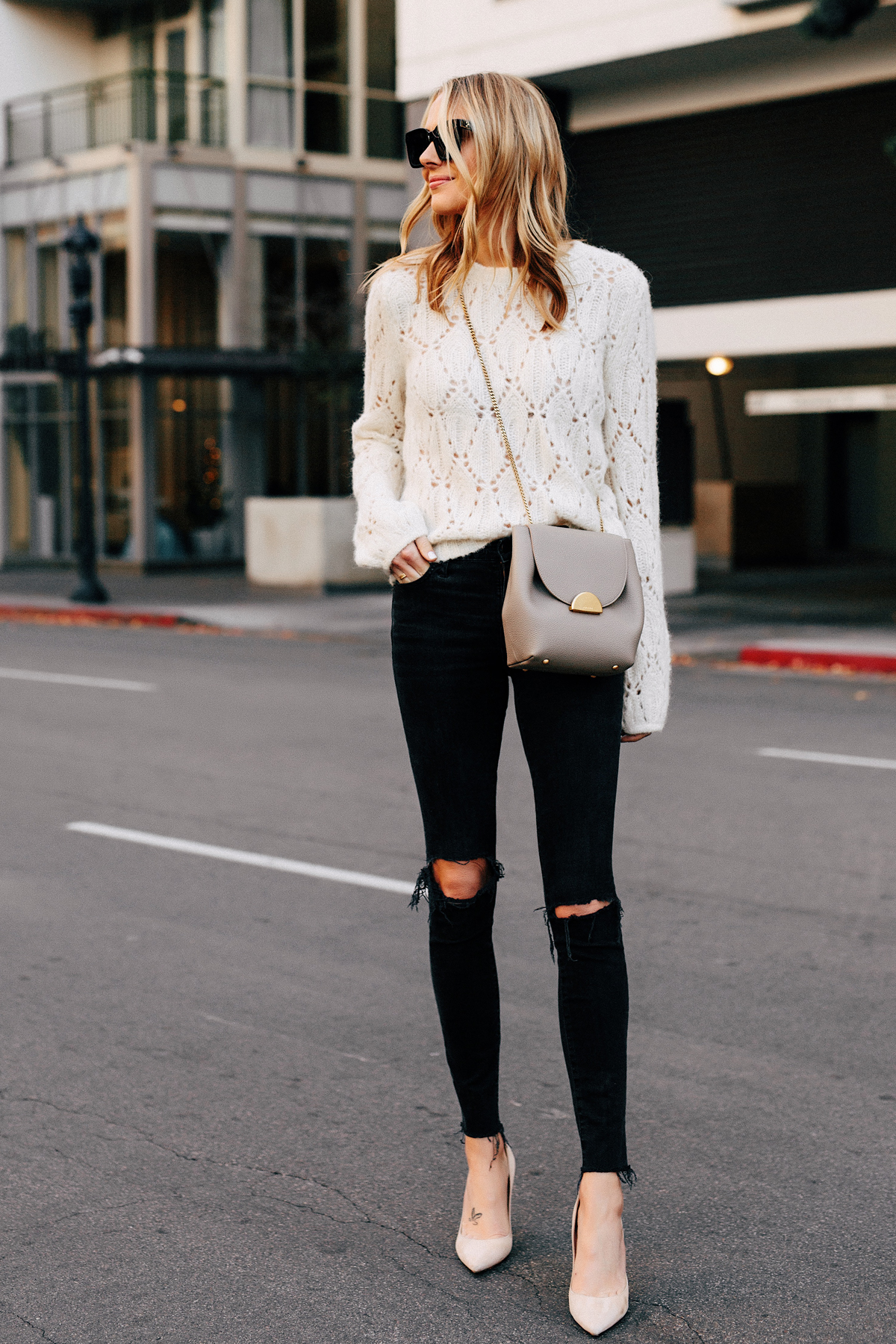 Blonde Woman Wearing Reformation White Pointelle Sweater Madewell Black Ripped Skinny Jeans Polene Grey Handbag Tan Pumps Fashion Jackson San Diego Fashion Blogger Street Style