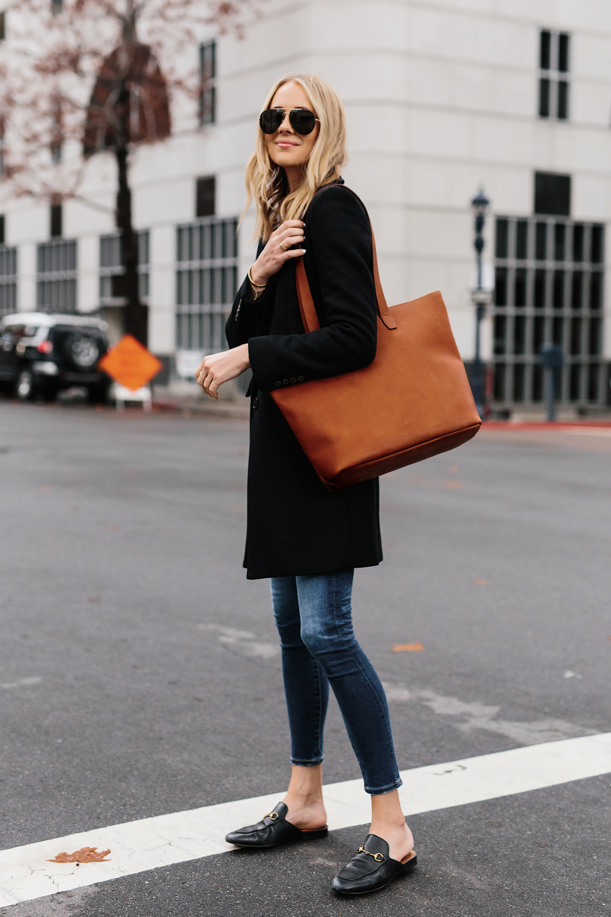 Blonde Woman Wearing SLATE Cognac Tote Black Wool Coat Denim Skinny Jeans Gucci Mules Outfit Fashion Jackson San Diego Fashion Blogger Street Style