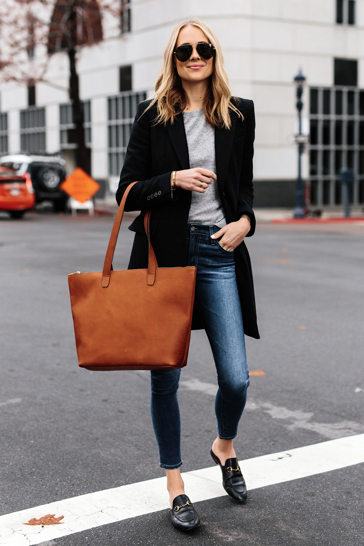 Blonde Woman Wearing SLATE Cognac Tote Black Wool Coat Grey Sweater Denim Skinny Jeans Gucci Mules Outfit Fashion Jackson San Diego Fashion Blogger Street Style