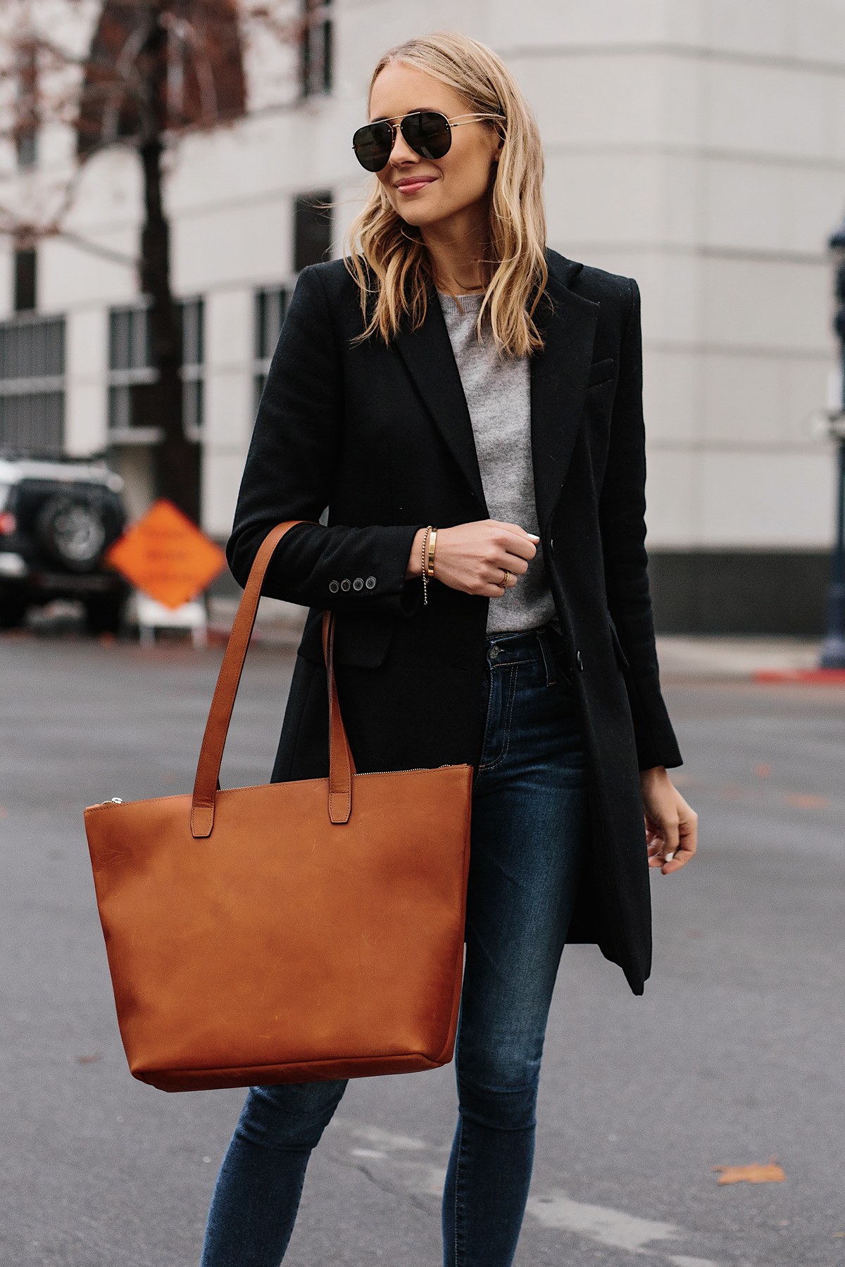 Blonde Woman Wearing SLATE Cognac Tote Black Wool Coat Grey Sweater Denim Skinny Jeans Outfit Fashion Jackson San Diego Fashion Blogger Street Style