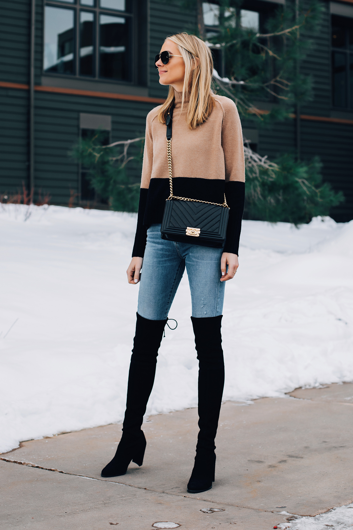 Blonde Woman Wearing Tan Black Color Block Sweater Denim Skinny Jeans Stuart Weitzman Black Over the Knee Boots Chanel Black Boy Handbag Fashion Jackson San Diego Fashion Blogger Winter Style