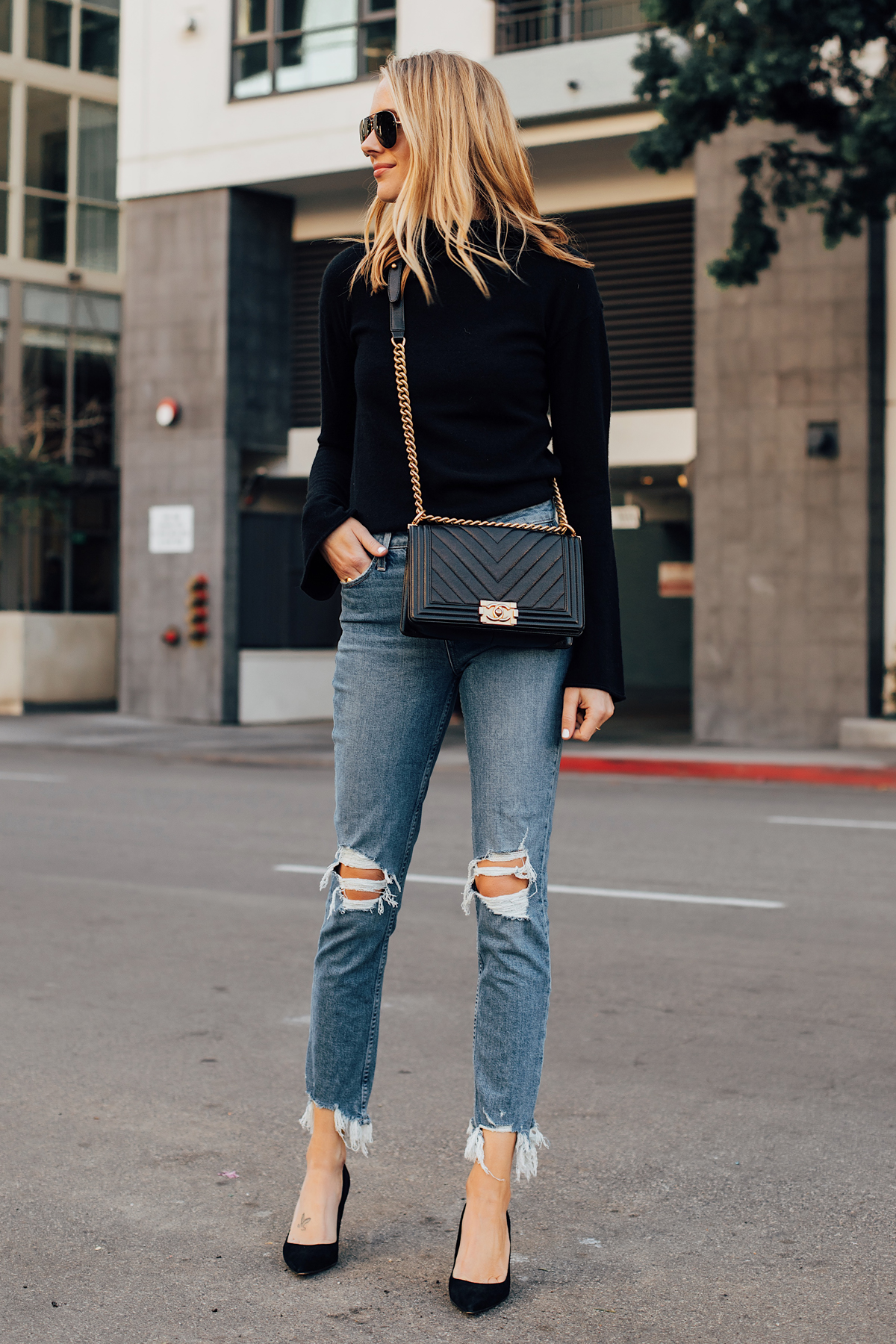 Blonde Woman Wearing Theory Black Bell Sleeve Sweater Paige Ripped Skinny Jeans Black Pumps Chanel Black Handbag Fashion Jackson San Diego Fashion Blogger Street Style