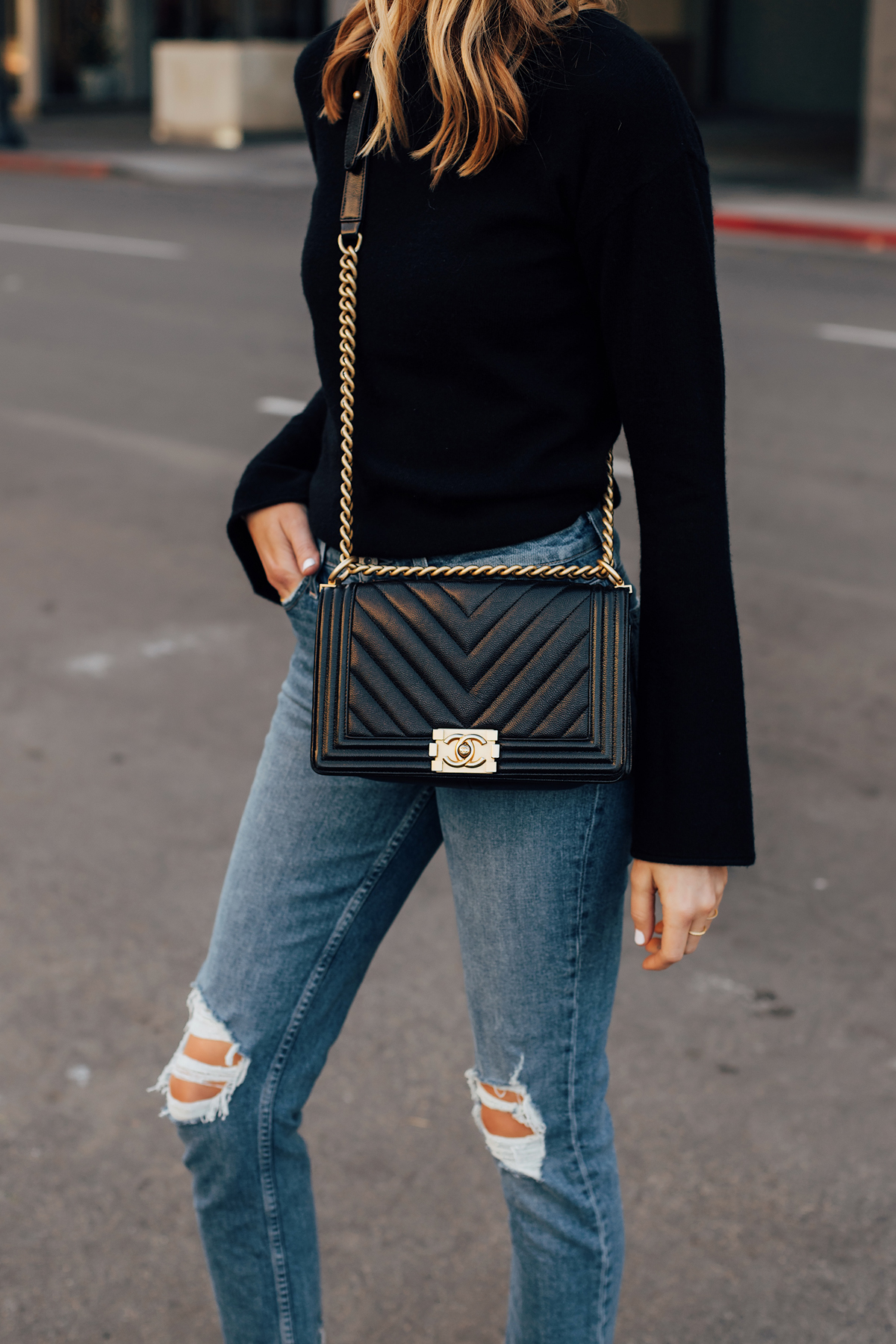 Blonde Woman Wearing Theory Black Bell Sleeve Sweater Paige Ripped Skinny Jeans Chanel Black Handbag Fashion Jackson San Diego Fashion Blogger Street Style