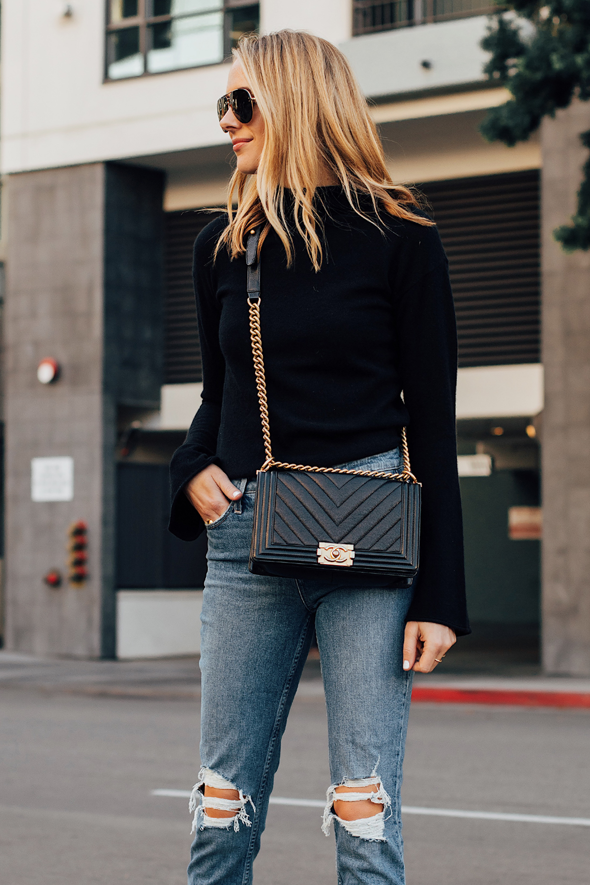 Blonde Woman Wearing Theory Black Sweater Paige Ripped Skinny Jeans Chanel Black Handbag Fashion Jackson San Diego Fashion Blogger Street Style