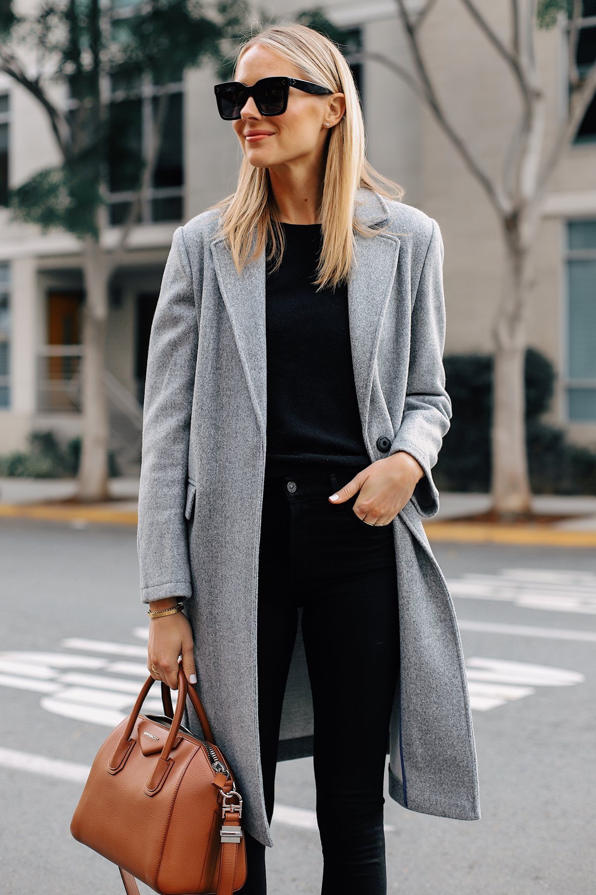 Blonde Woman Wearing Topshop Grey Coat Black Sweater Black Skinny Jeans Tan Satchel Handbag Fashion Jackson San Diego Fashion Blogger Street Style