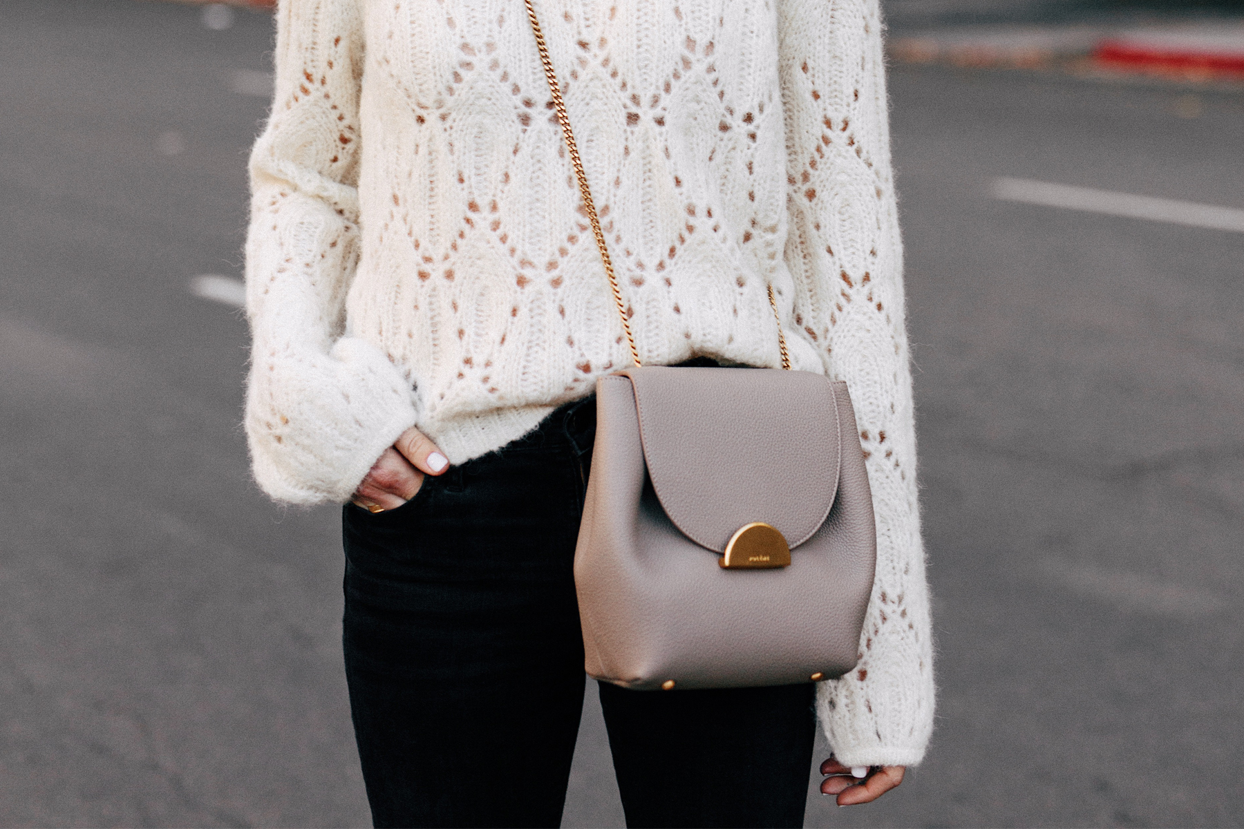 Woman Wearing White Pointelle Sweater Black Skinny Jeans Polene Grey Handbag Fashion Jackson San Diego Fashion Blogger Street Style