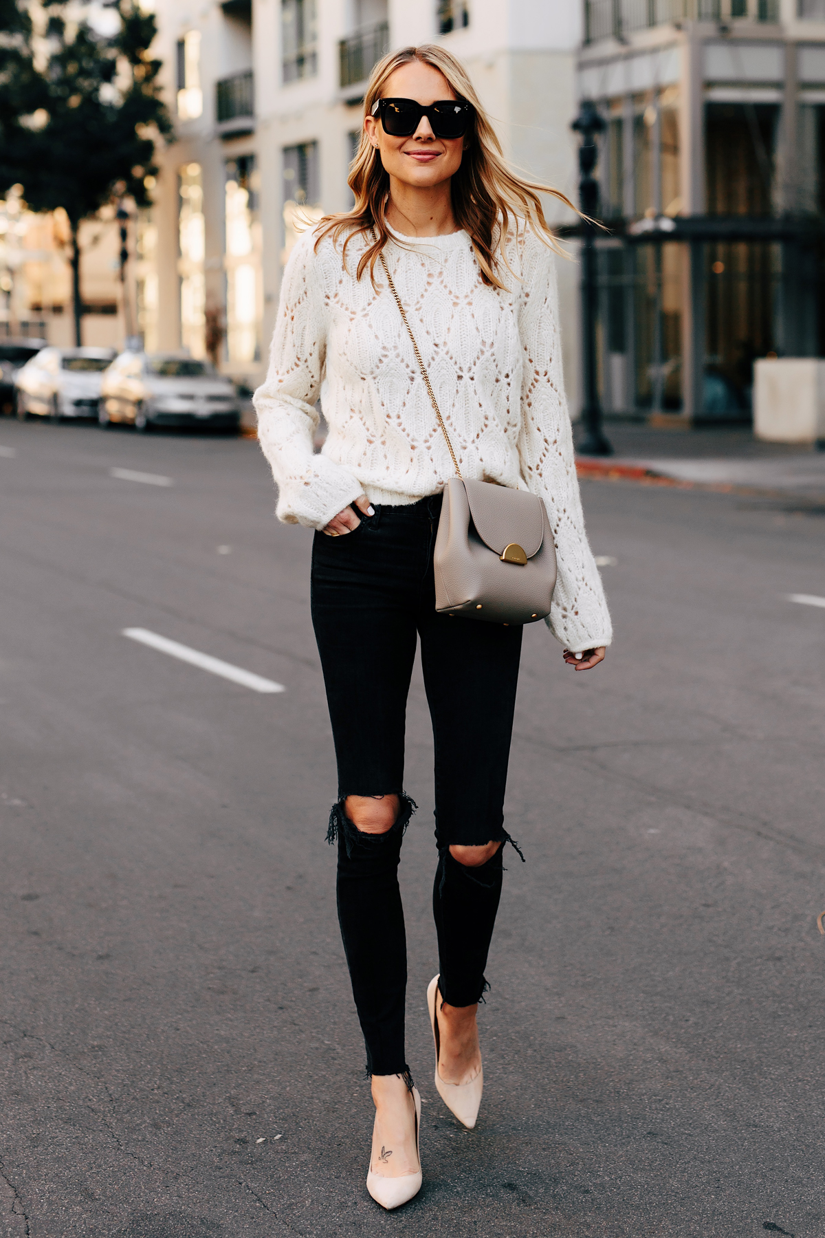 Blonde Woman Wearing White Pointelle Sweater Black Skinny Jeans Polene Grey Handbag Fashion Jackson San Diego Fashion Blogger Street Style