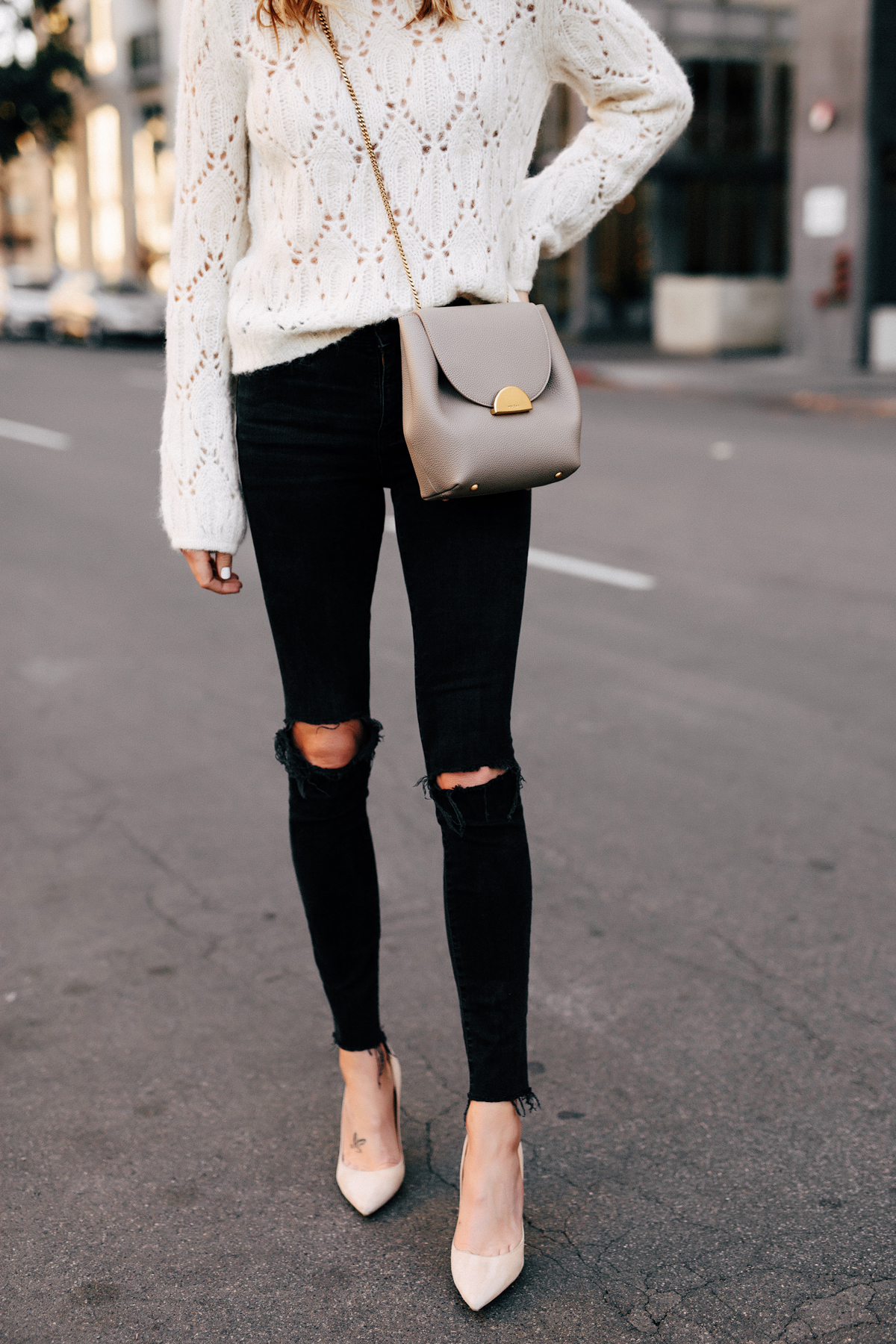 Woman Wearing White Pointelle Sweater Madewell Black Ripped Skinny Jeans Nude Pumps Polene Grey Handbag Fashion Jackson San Diego Fashion Blogger Street Style