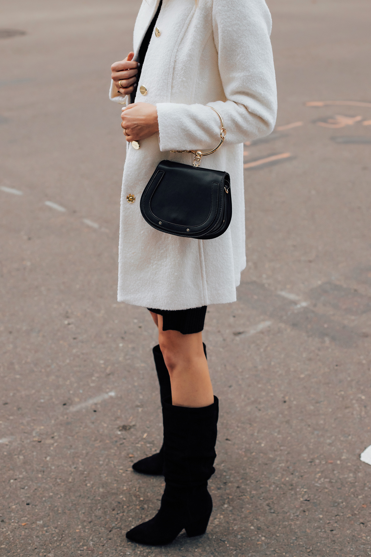 Blonde Woman Wearing Winter White Coat Black Slouchy Boots Black Clutch Handbag Fashion Jackson San Diego Fashion Blogger Street Style