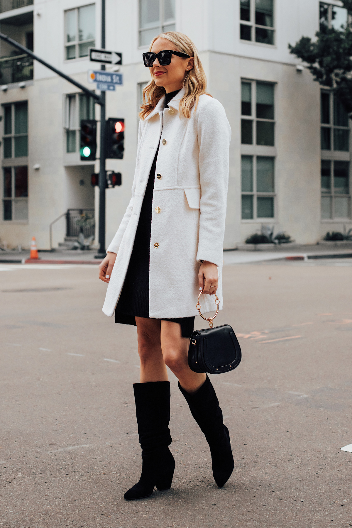 Blonde Woman Wearing Winter White Coat Black Sweater Dress Black Slouchy Boots Fashion Jackson San Diego Fashion Blogger Holiday Style