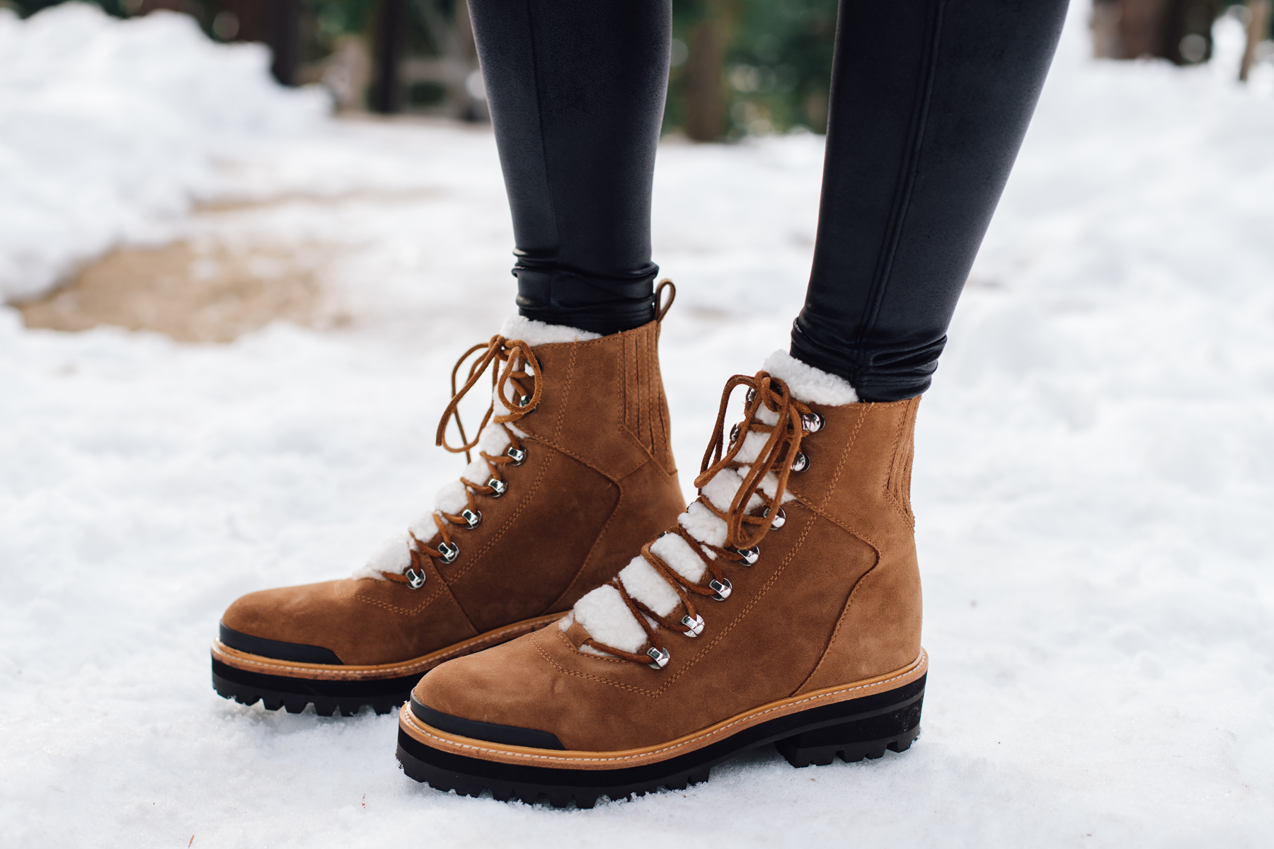 Fashion Jackson wearing Marc Fisher Shearling Brown Lace Up Booties