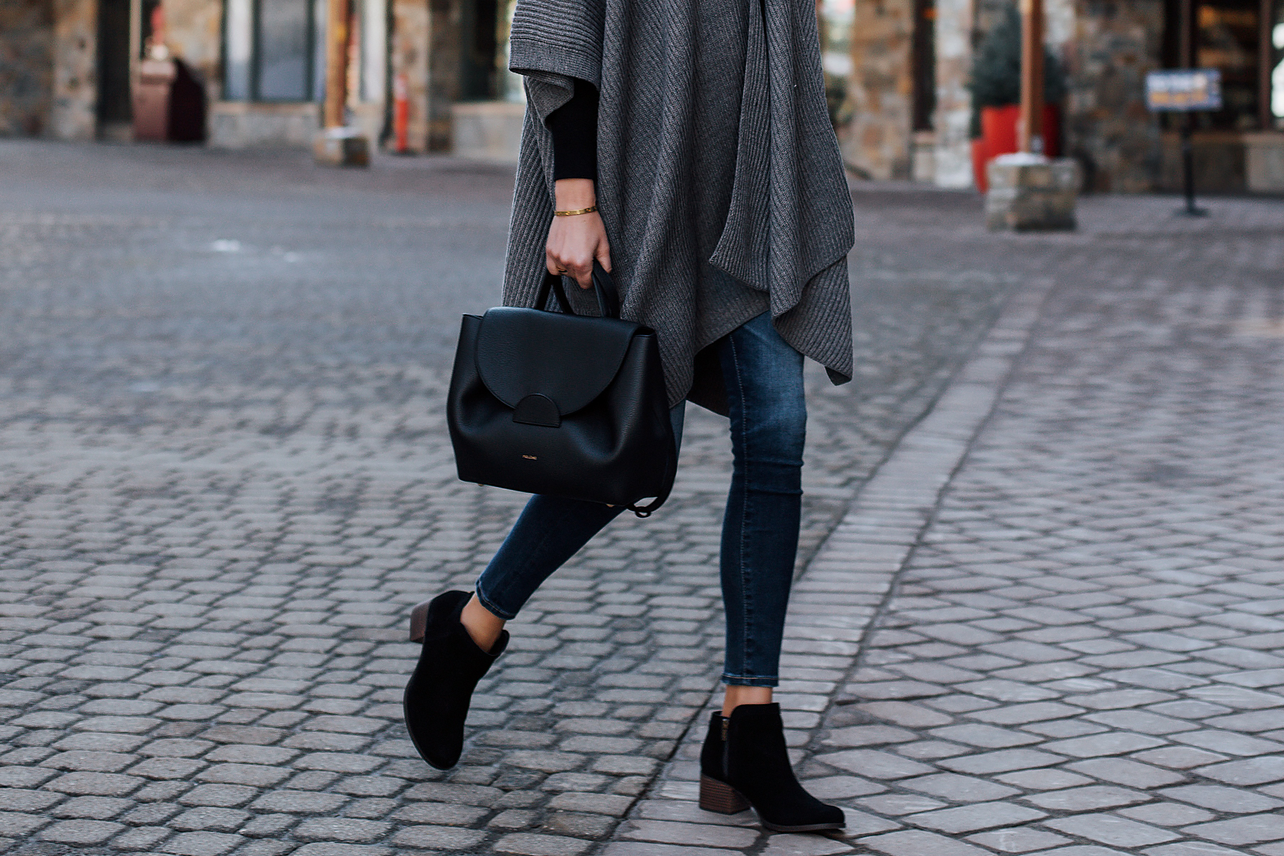 Fashion Jackson Wearing Koolaburra Thia Black Booties Grey Poncho Sweater Denim Ripped Skinny Jeans Polene Handbag Fashion Jackson San Diego Fashion Blogger Street Style
