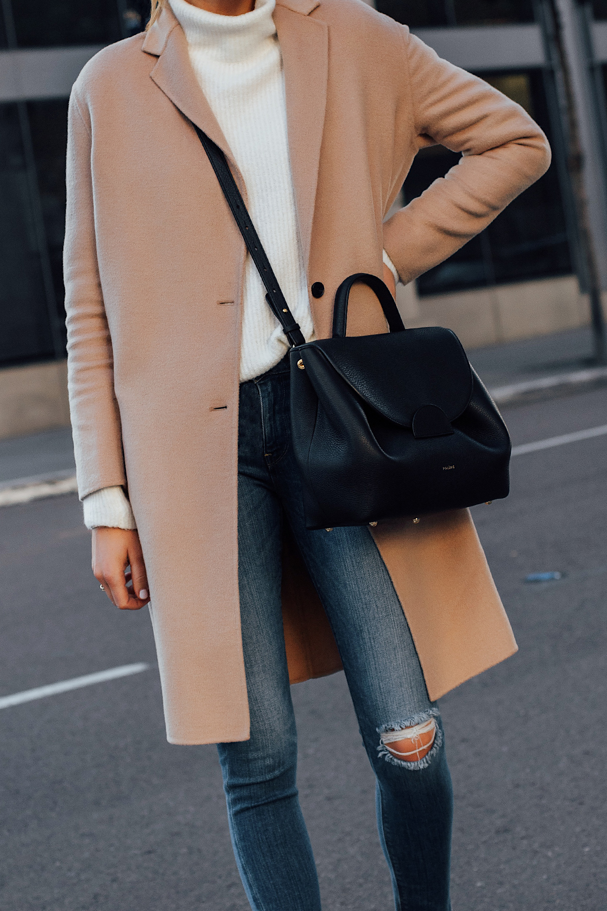 Woman Wearing AllSaints Camel Coat White Sweater Denim Ripped Skinny Jeans Polene Black Handbag Fashion Jackson San Diego Fashion Blogger Street Style