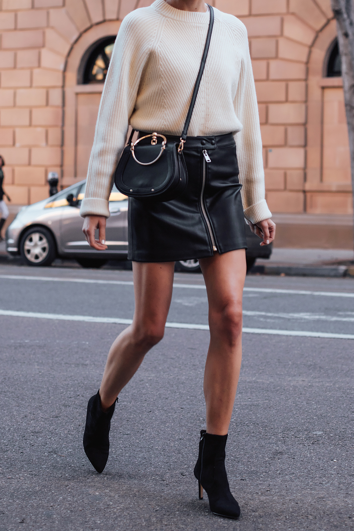 Woman Wearing AllSaints White Sweater Black Faux Leather Mini Skirt Black Chloe Nile Dupe Black Ankle Booties Fashion Jackson San Diego Fashion Blogger Street Style