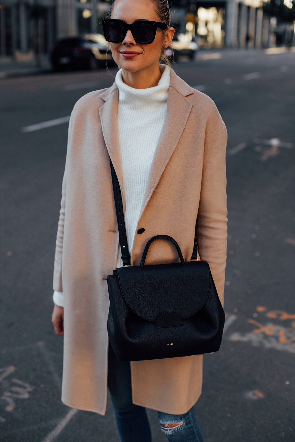 Blonde Woman Wearing AllSaints Camel Coat White Sweater Denim Skinny Ripped Jeans Polene Black Handbag Fashion Jackson San Diego Fashion Blogger Street Style