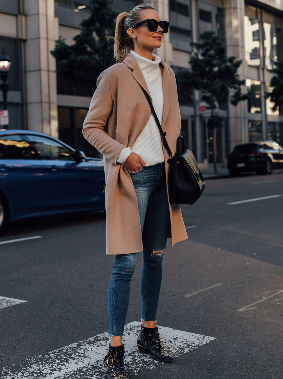 Blonde Woman Wearing AllSaints Camel Coat White Sweater Hudson Denim Ripped Skinny Jeans Chloe Black Susanna Booties Black Handbag Fashion Jackson San Diego Fashion Blogger Street Style