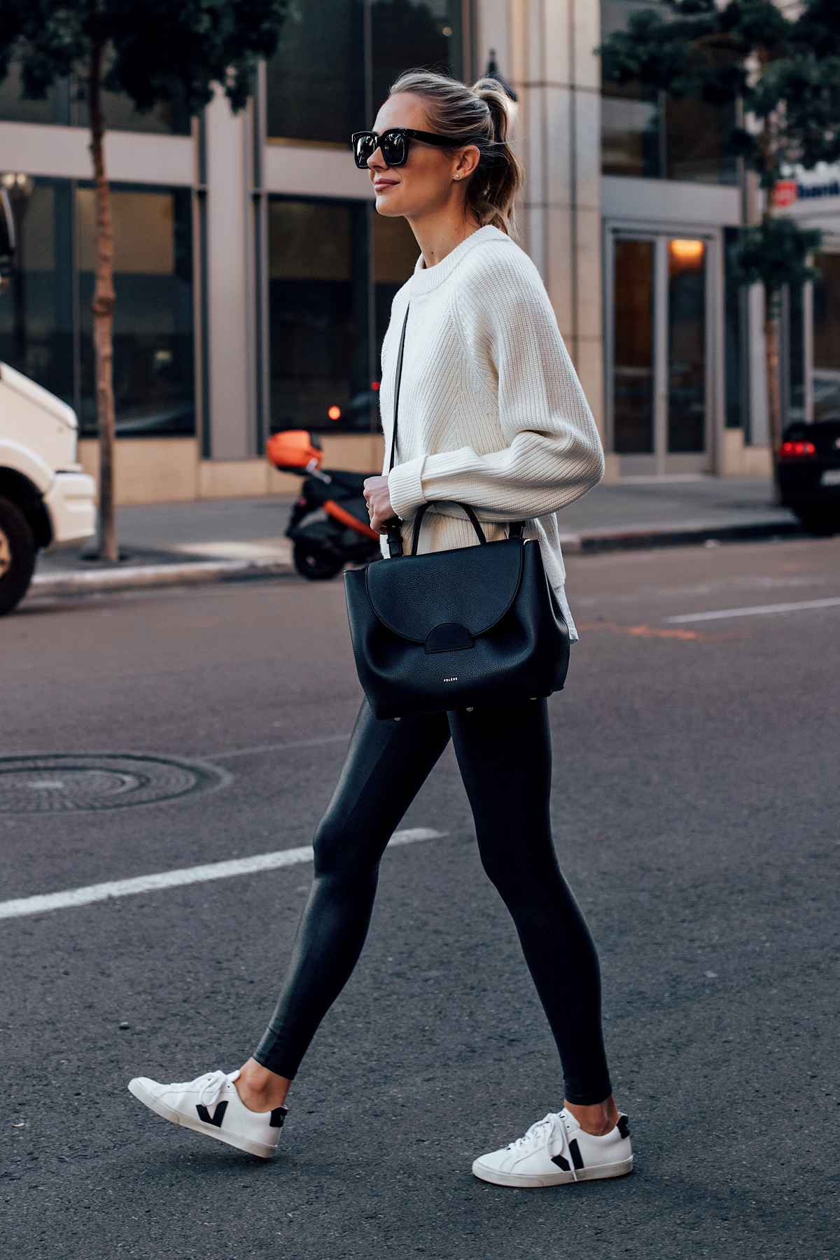 Blonde Woman Wearing Allsaints White Sweater Spanx Black Faux Leather Leggings Veja Espalar White Sneakers Polene Black Handbag Fashion Jackson San Diego Fashion Blogger Street Style