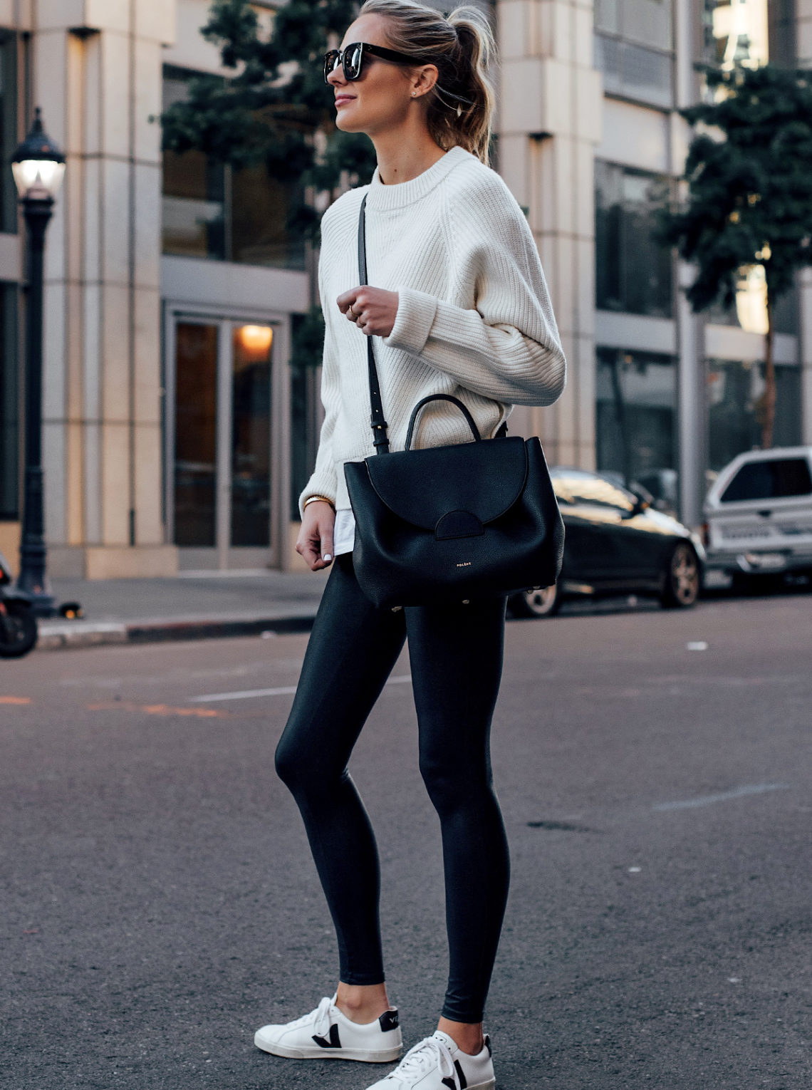 Blonde Woman Wearing Allsaints White Sweater White Tshirt Spanx Black Faux Leather Leggings Veja Espalar White Sneakers Polene Black Handbag Fashion Jackson San Diego Fashion Blogger Street Style