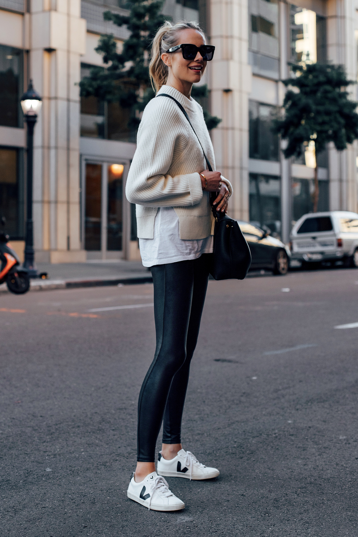 Blonde Woman Wearing Allsaints White Sweater White Tshirt Spanx Black Faux Leather Leggings Veja Espalar White Sneakers Fashion Jackson San Diego Fashion Blogger Street Style