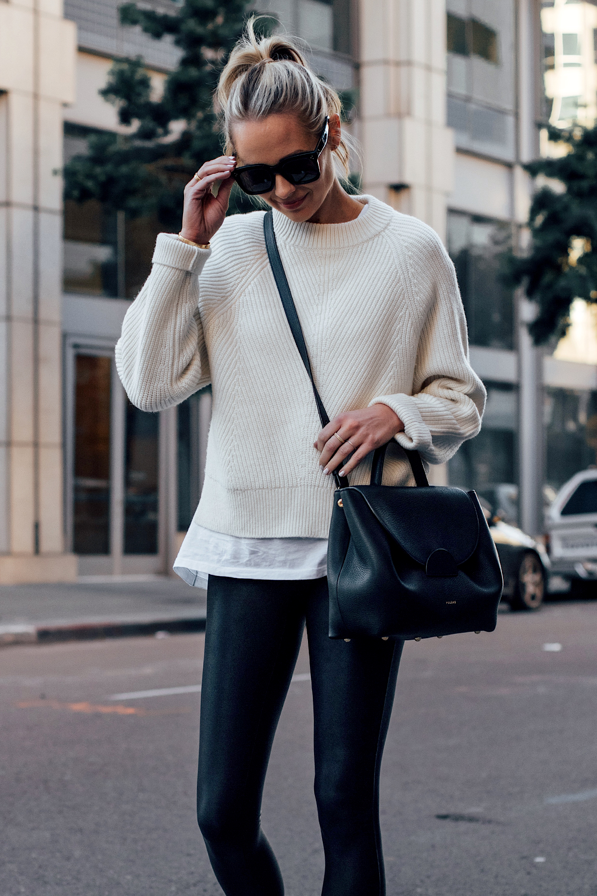 Blonde Woman Wearing Allsaints White Sylvie Sweater White Tshirt Black Faux Leather Leggings Polene Black Number One Handbag Fashion Jackson San Diego Fashion Blogger Street Style