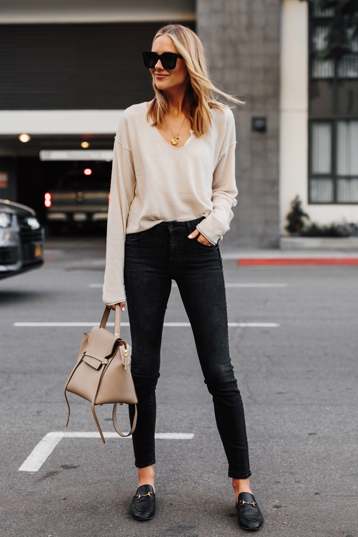Blonde Woman Wearing Beige Sweater Black Skinny Jeans Gucci Princetown Black Mules Celine Mini Belt Bag Fashion Jackson San Diego Fashion Blogger Street Style
